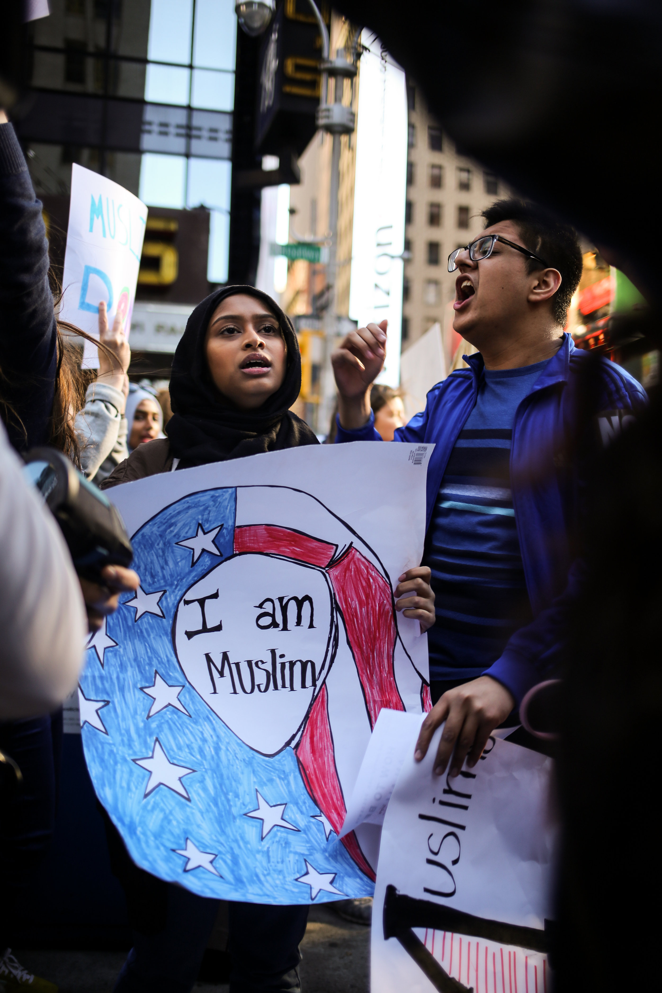 A Muslim girl and a group of her friends shout loudly about freedom of speech and hate crimes at the I Am A Muslim Too Rally // February 19th, 2017 // New York City.
