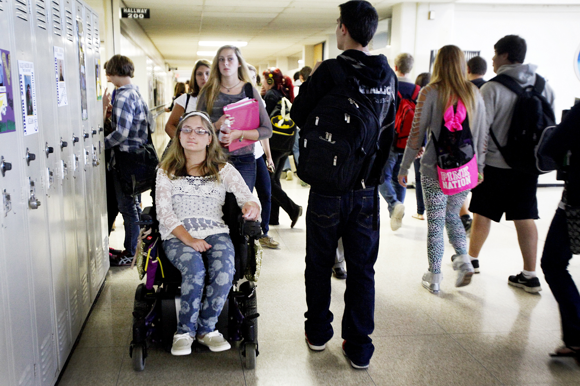 Emily Lezon heads to class among the flood of students at Vermilion High School Monday, October 14.