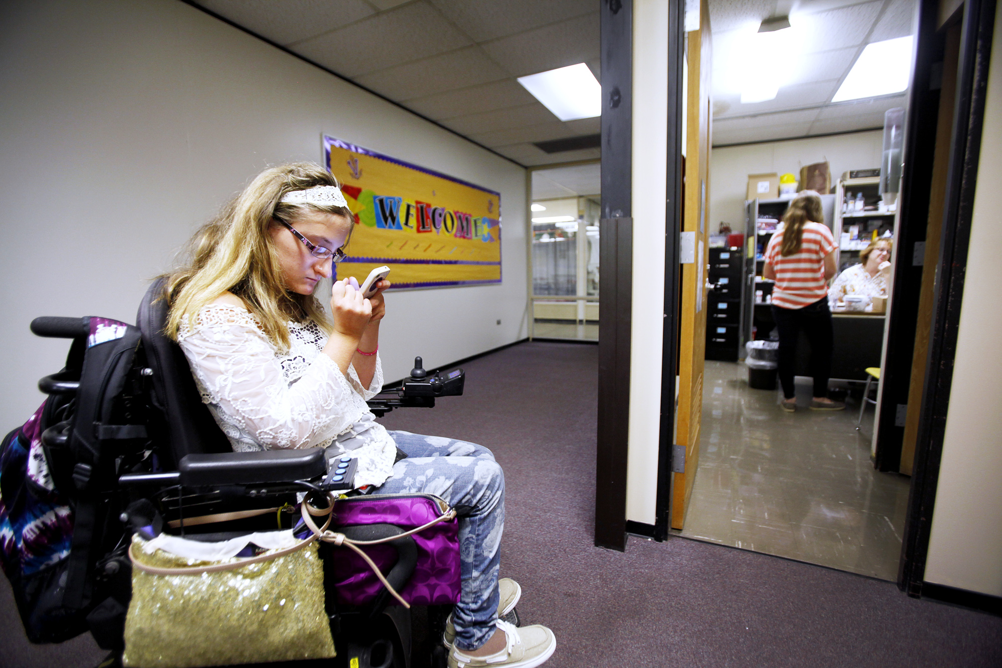 Emily Lezon waits at the nurse's office for help using the restroom during school Monday, October 14.