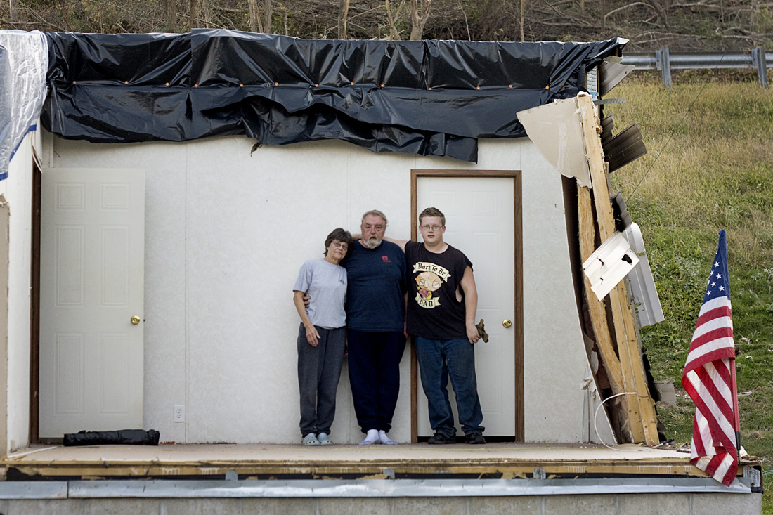Marilyn and Garry Weddington stand in their bedroom with their son, Michael on October 10.
