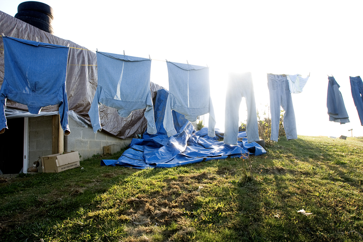 Clothes blow in the wind as Shirley does laundry outside.