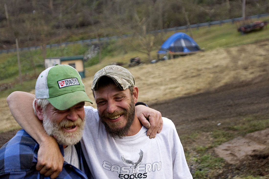 Jason recalls the immediate help after the storm from strangers, neighbors and friends and puts his arm around Brian in appreciation on October 3.