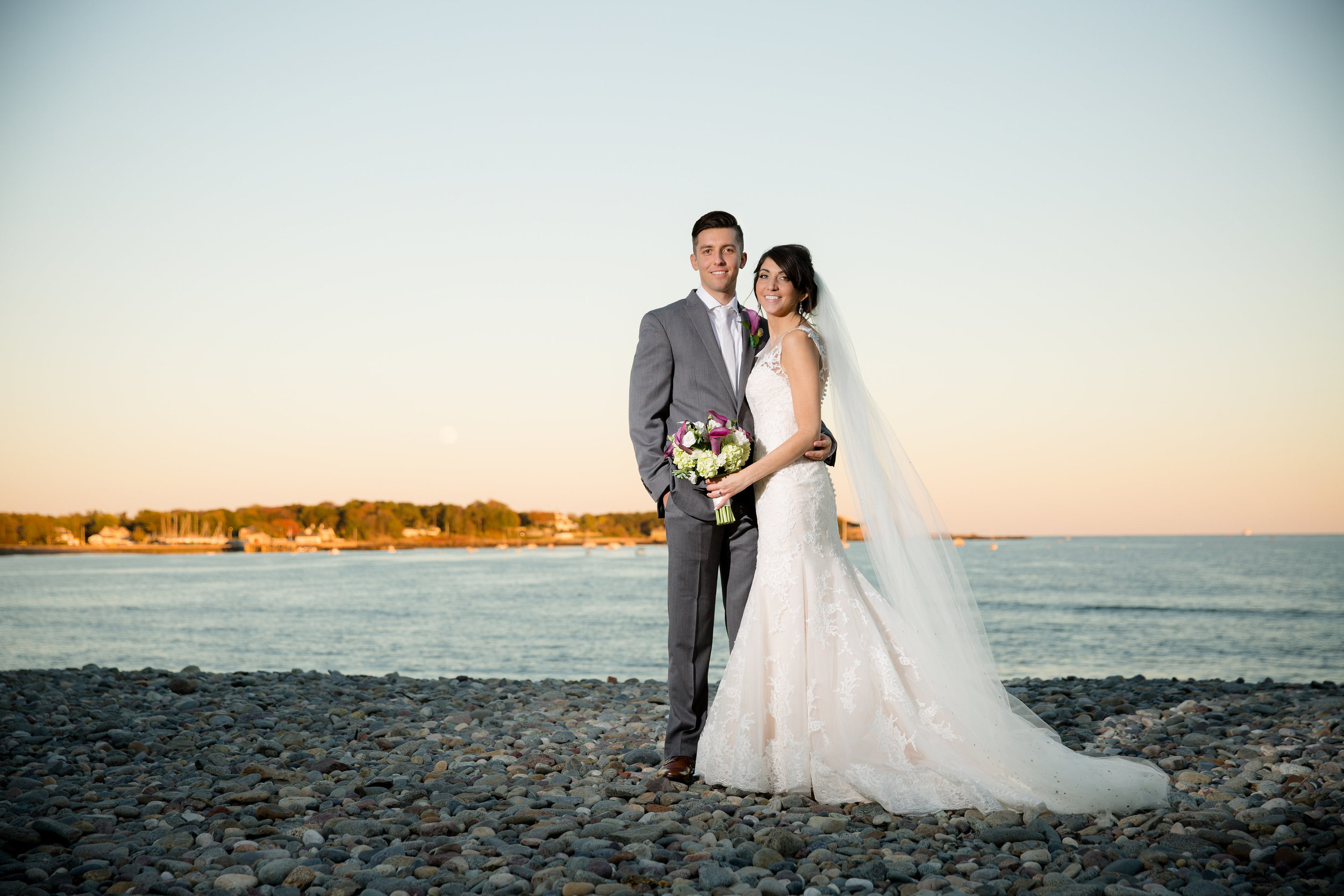 bride and groom on beach in nahant
