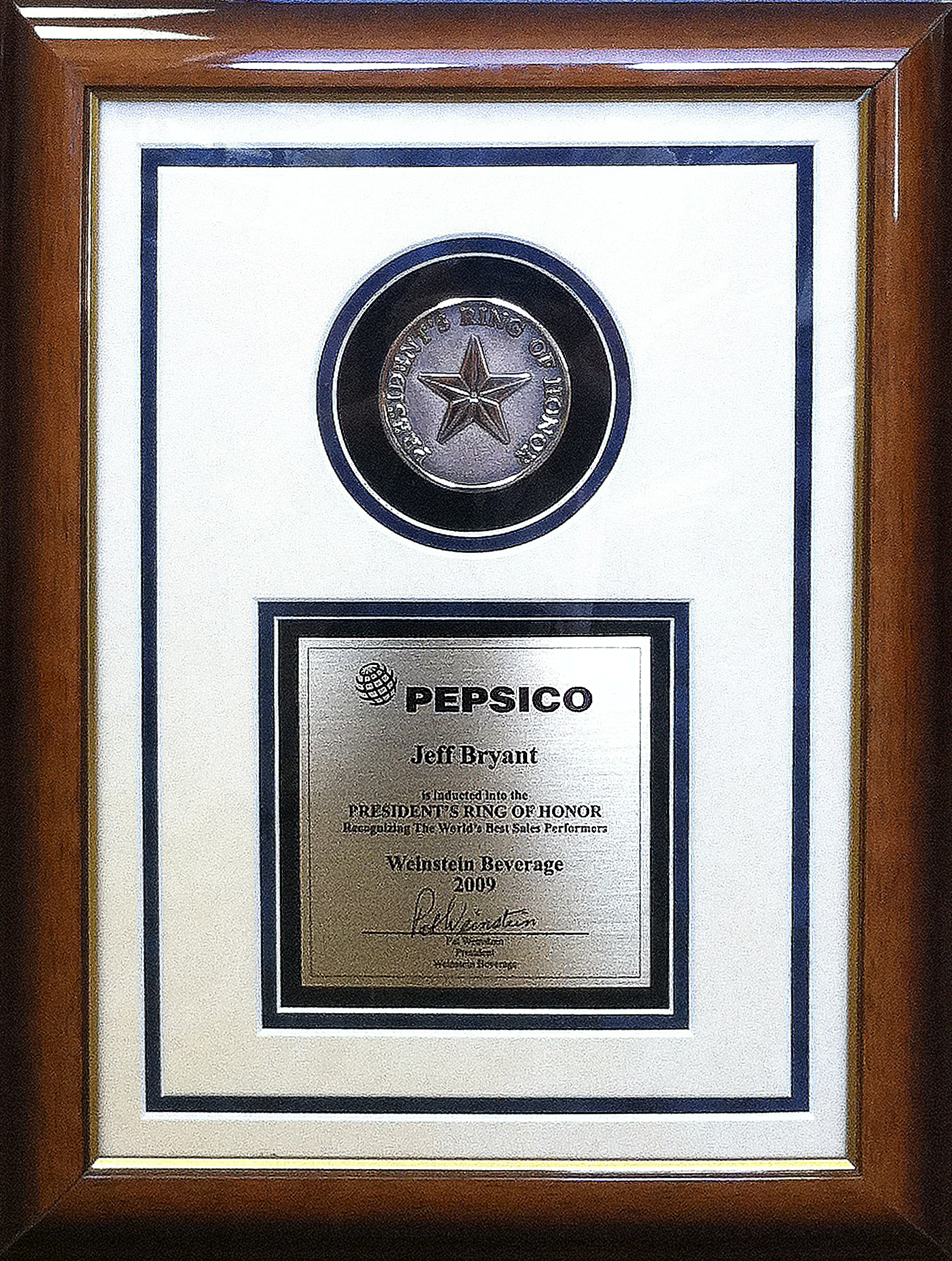 PepsiCo Ring of Honor outstanding service award presented to Jeff Bryant - Sales Manager at Weinstein Beverage Company.