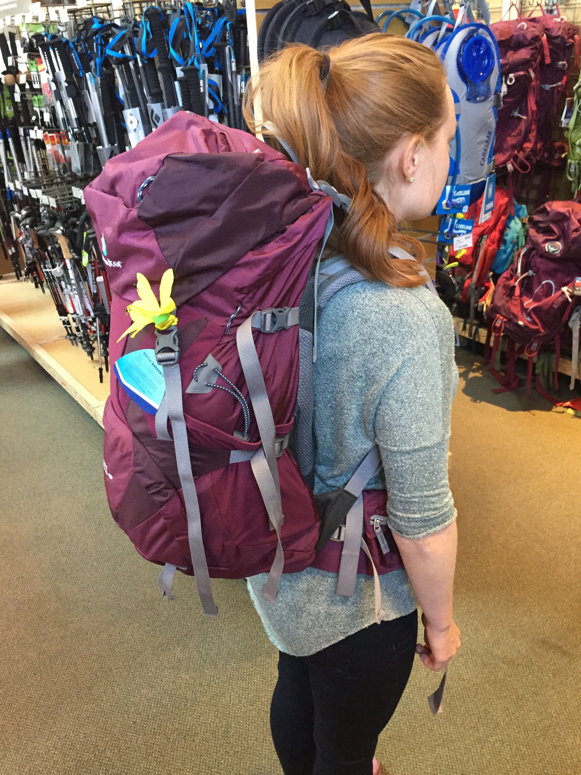 The first time I tried on my pack in REI! (They fill it with bags of sand so you can tell if it fits correctly when it's full.)
