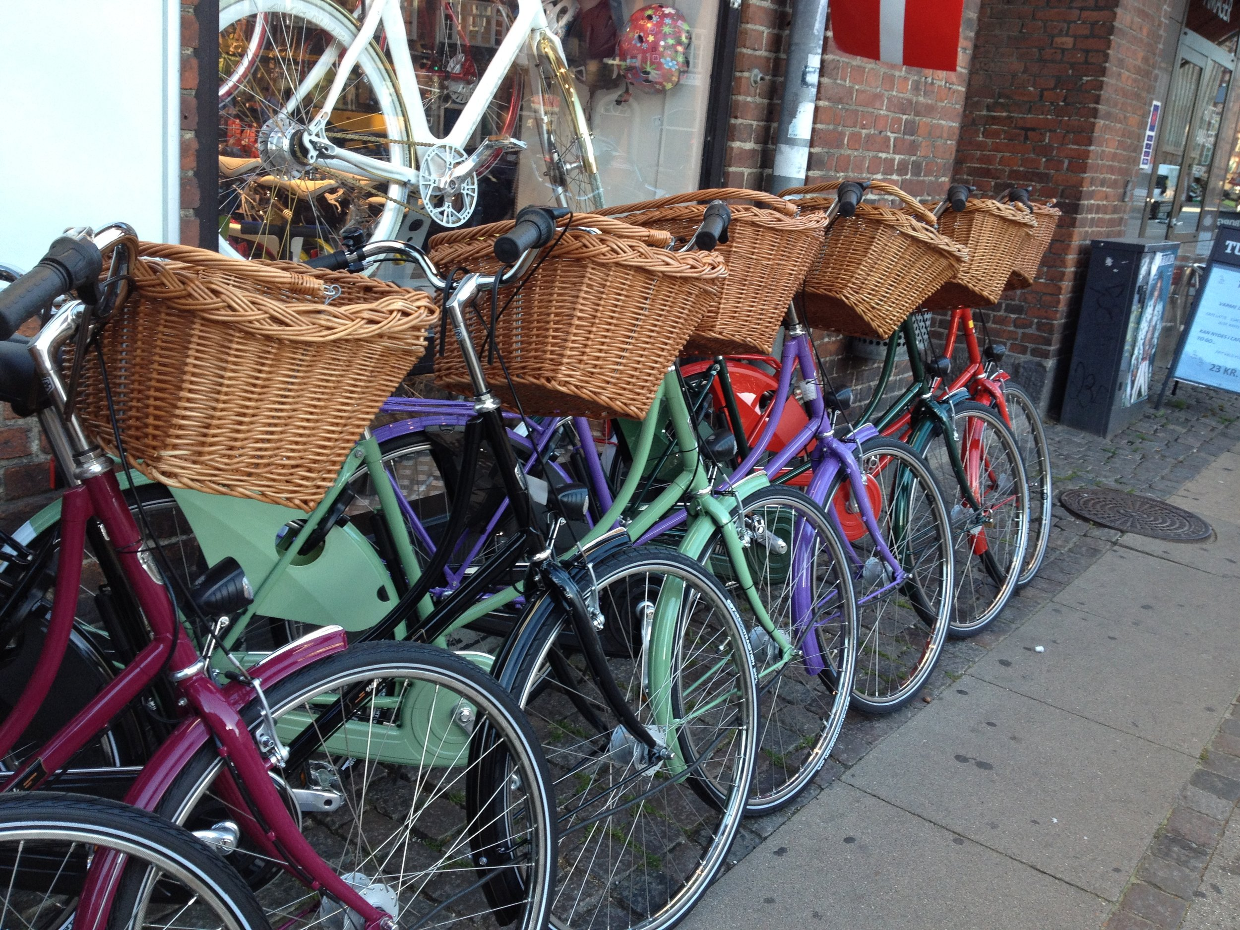 Row of colorful bicycles with baskets