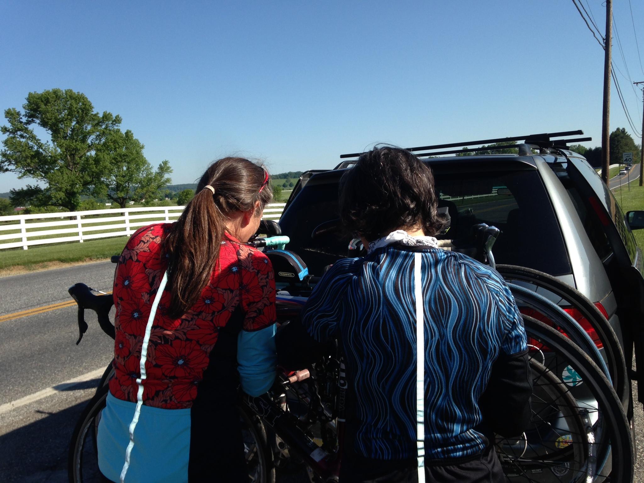 Women wearing cycling jerseys with reflective stripe on back