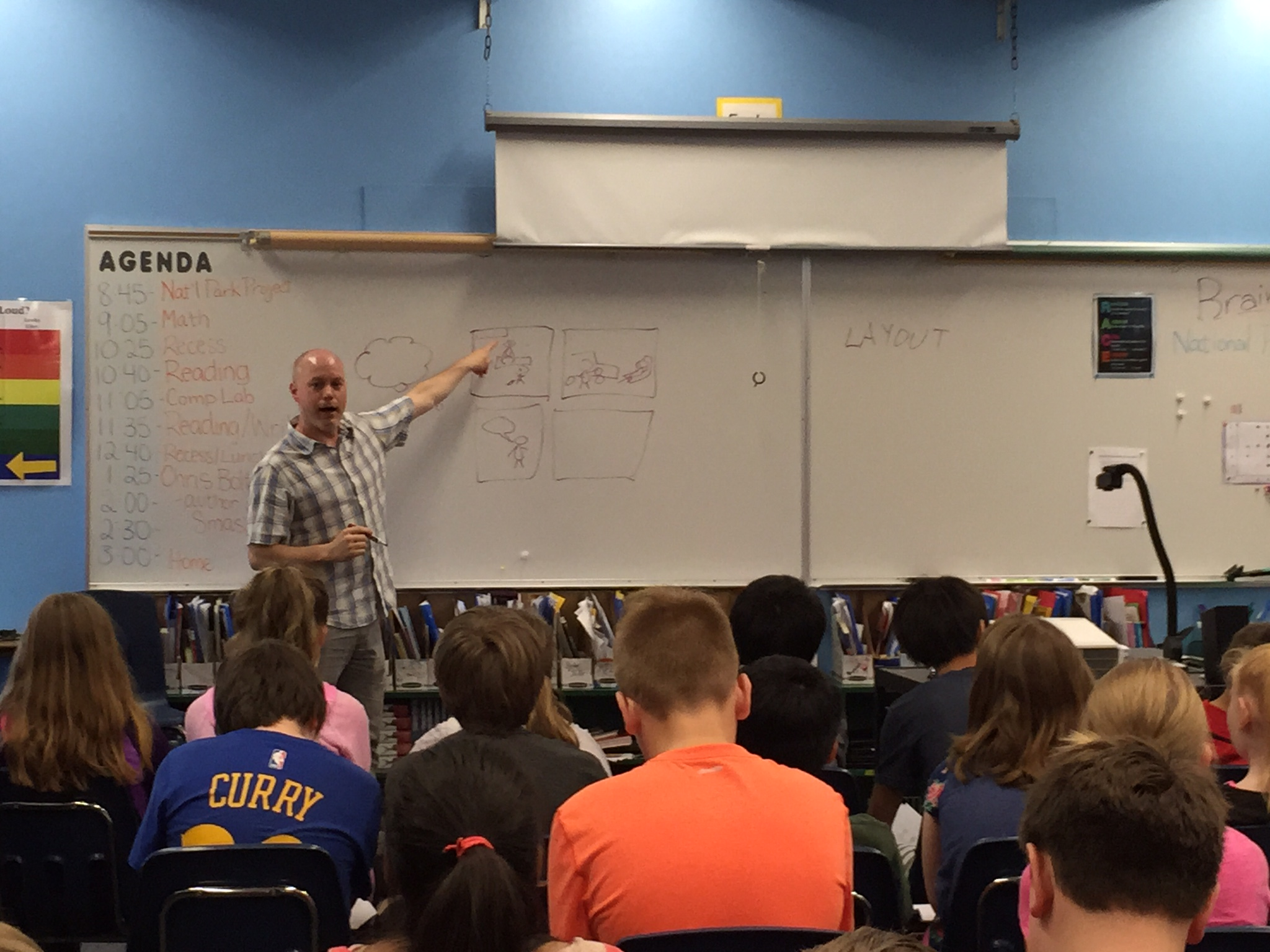 Chris shows the kids how to thumbnail a comic page.