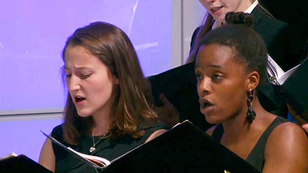 Georgetown University Chamber Singers Katherine Landau (SFS'17), left, and Morgan Callwood (C'19) perform during a concert at the Kennedy Center for Performing Arts held in honor of the papal visit.