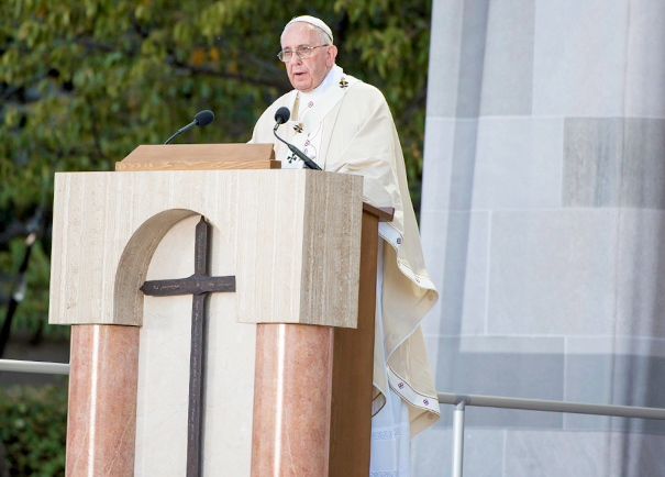 Pope Francis stands at the lectern, which displays the historic iron cross provided by Georgetown, during Mass at the Basilica of the National Shrine of the Immaculate Conception on Sept. 23.  Photo by Ed Pfueller, Catholic University of America