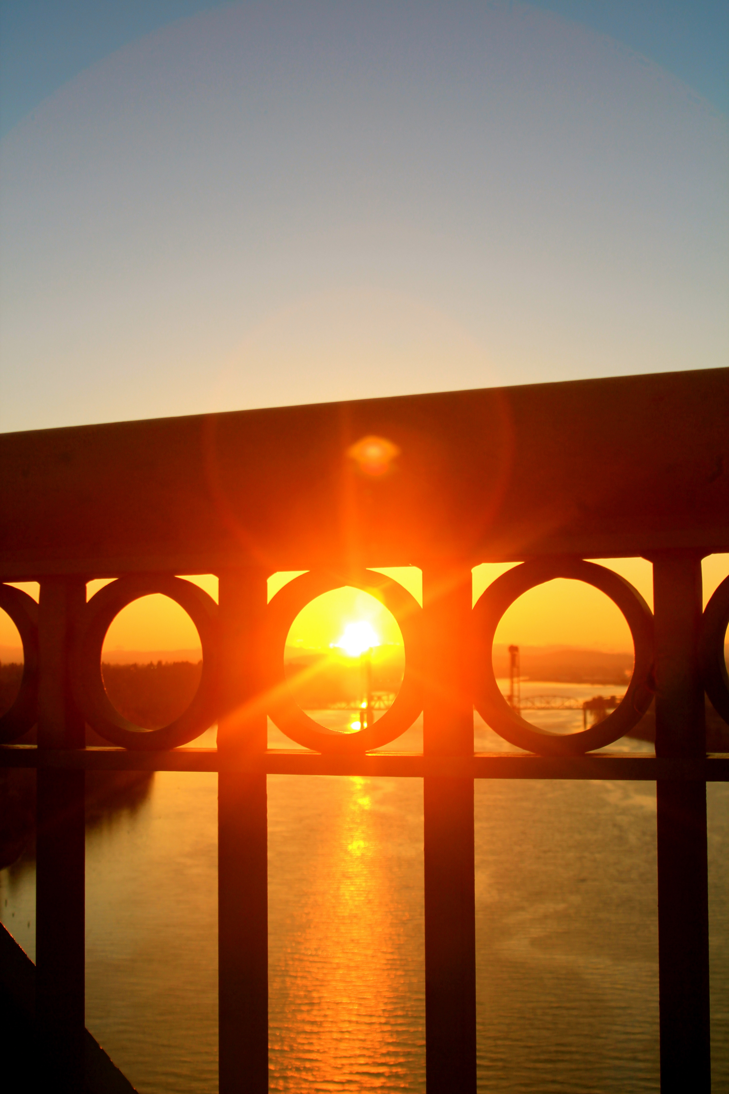 The sun peeks through the St. John's Bridge on an early morning in December.