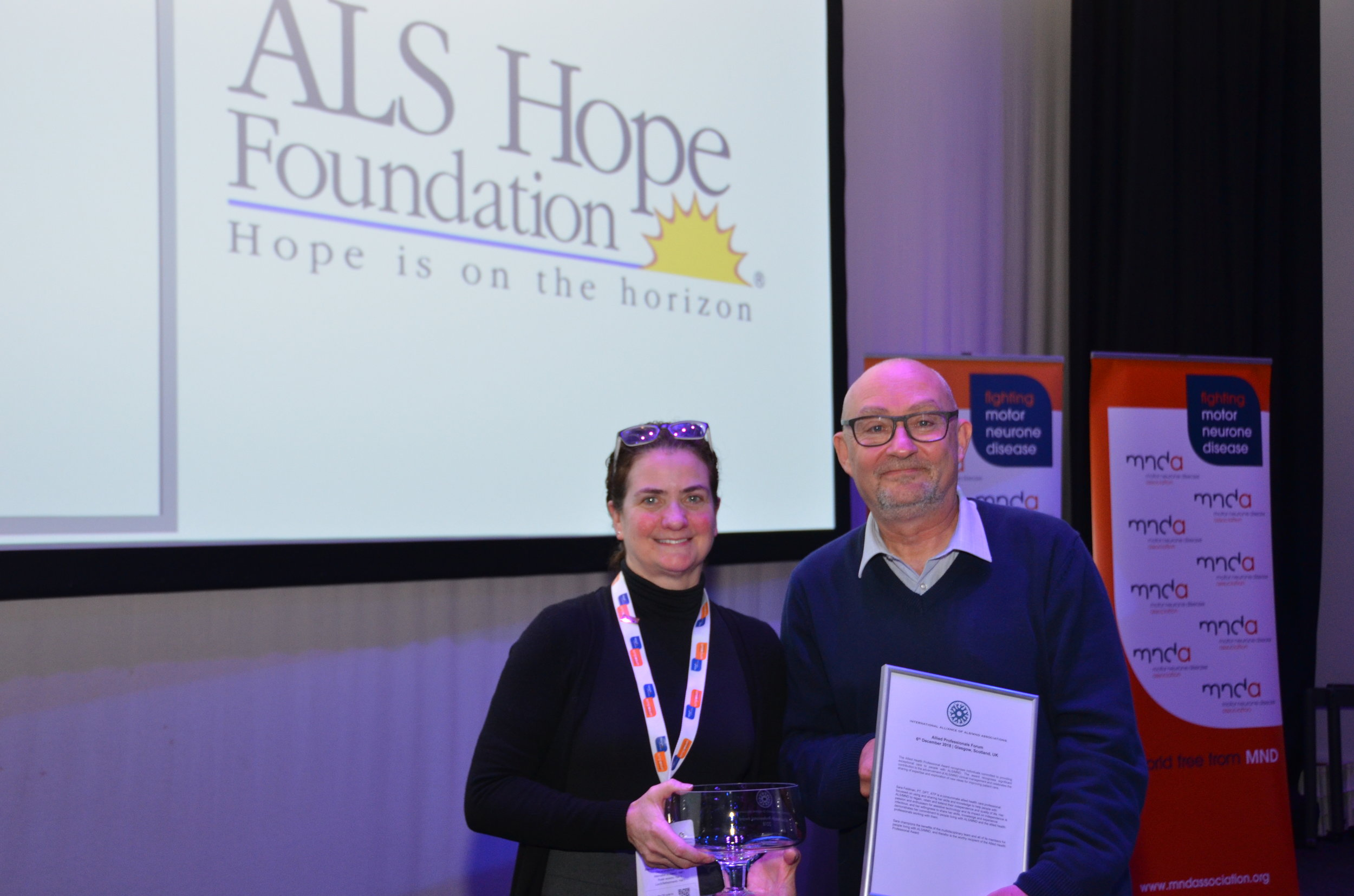 Steven Bell (MNDA), outgoing Chair of the International Alliance of ALS/MND Associations presents the Allied Health Professionals Award to Sara Feldman.