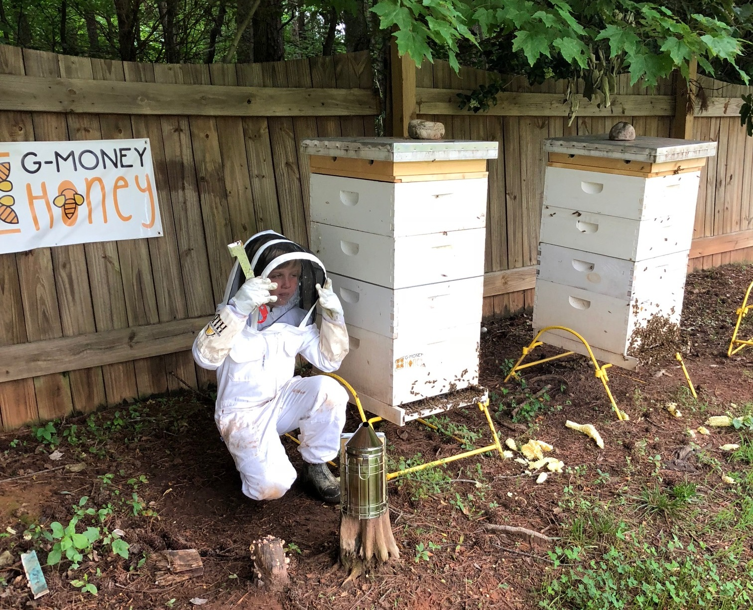 Grayson at work with his bee hives.  Photo: Aubrey Linville