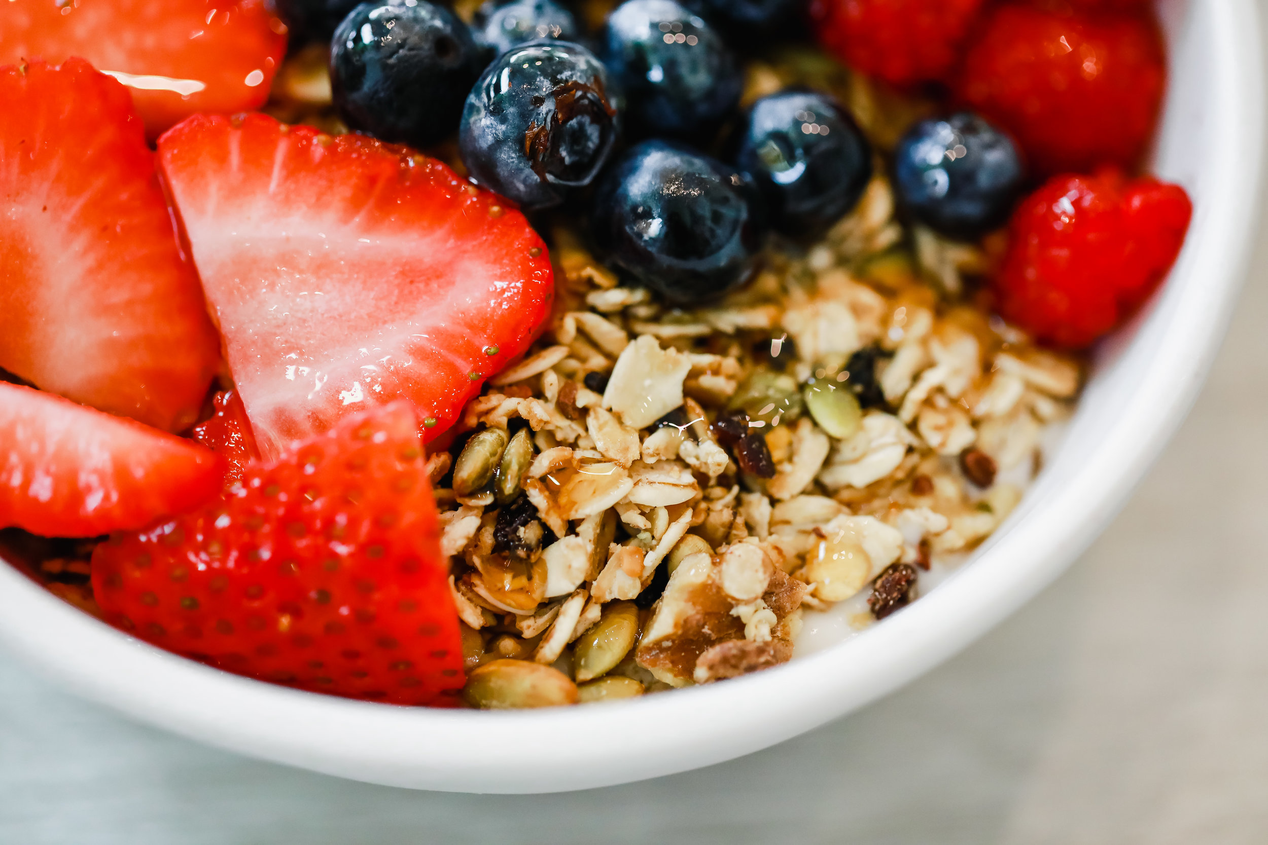 Our    Granola Girl yogurt bowl    drizzled with G-Money Honey    Photo: Lindley Battle Photography