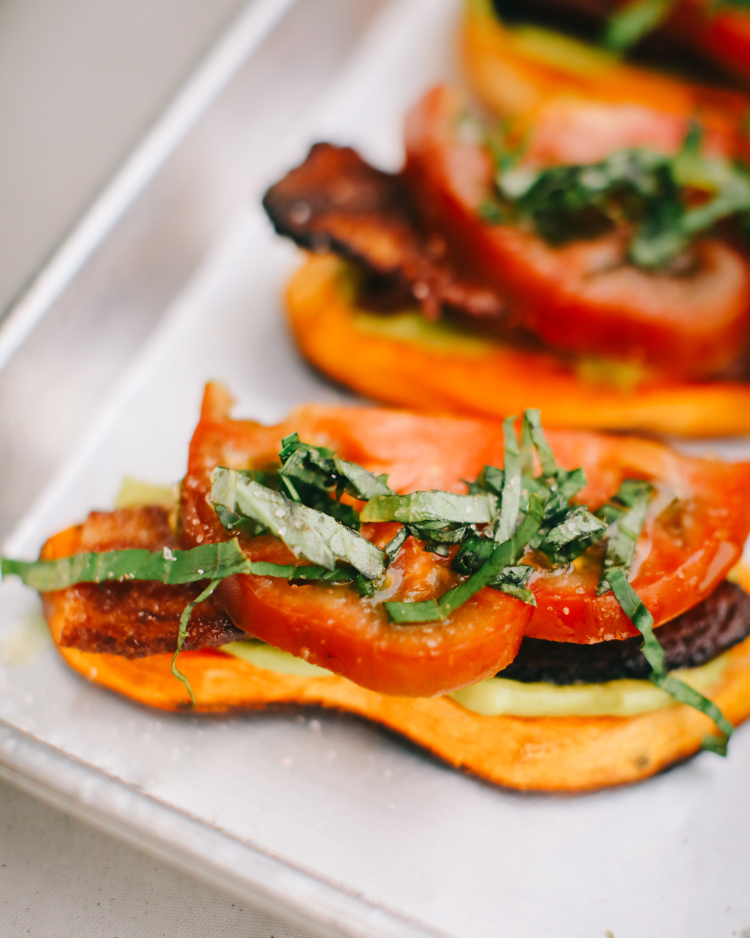 The  Basil, Bacon, & Tomato  toast on sliced sweet potatoes.   Lindley Battle Photography