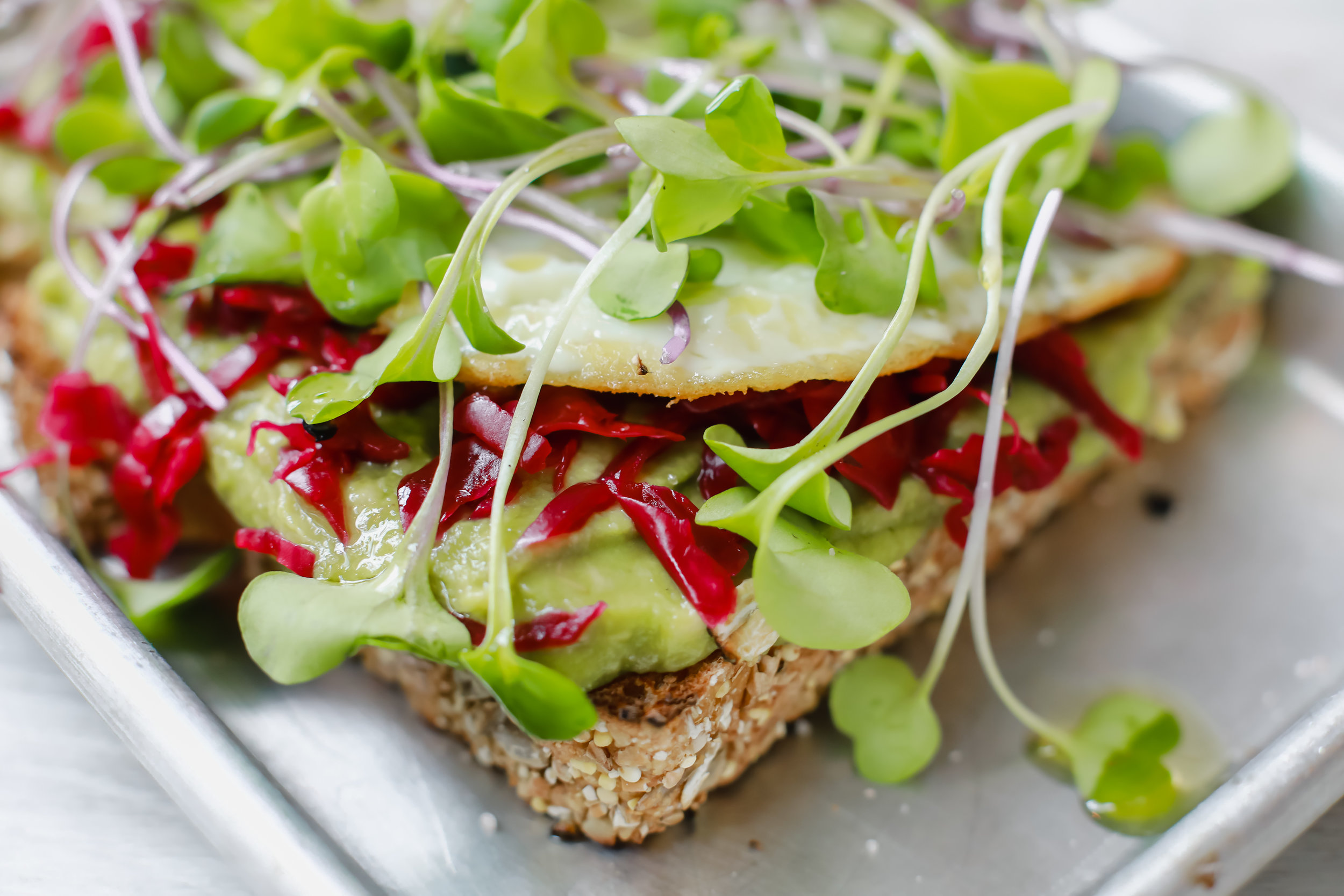 A close up of the royal curtido on our  Avo-Vegan toast    Photo: Lindley Battle Photography