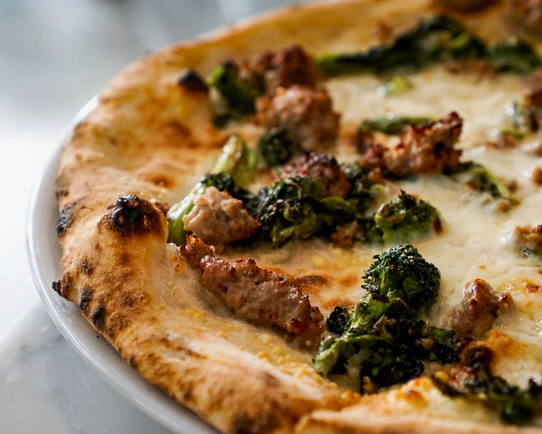 The Carrettiera Pizza has broccoli rabe and Italian sausage and may be the absolute go-to, dunk in the spicy oil, get a great bottle of wine cure for EVERYTHING.