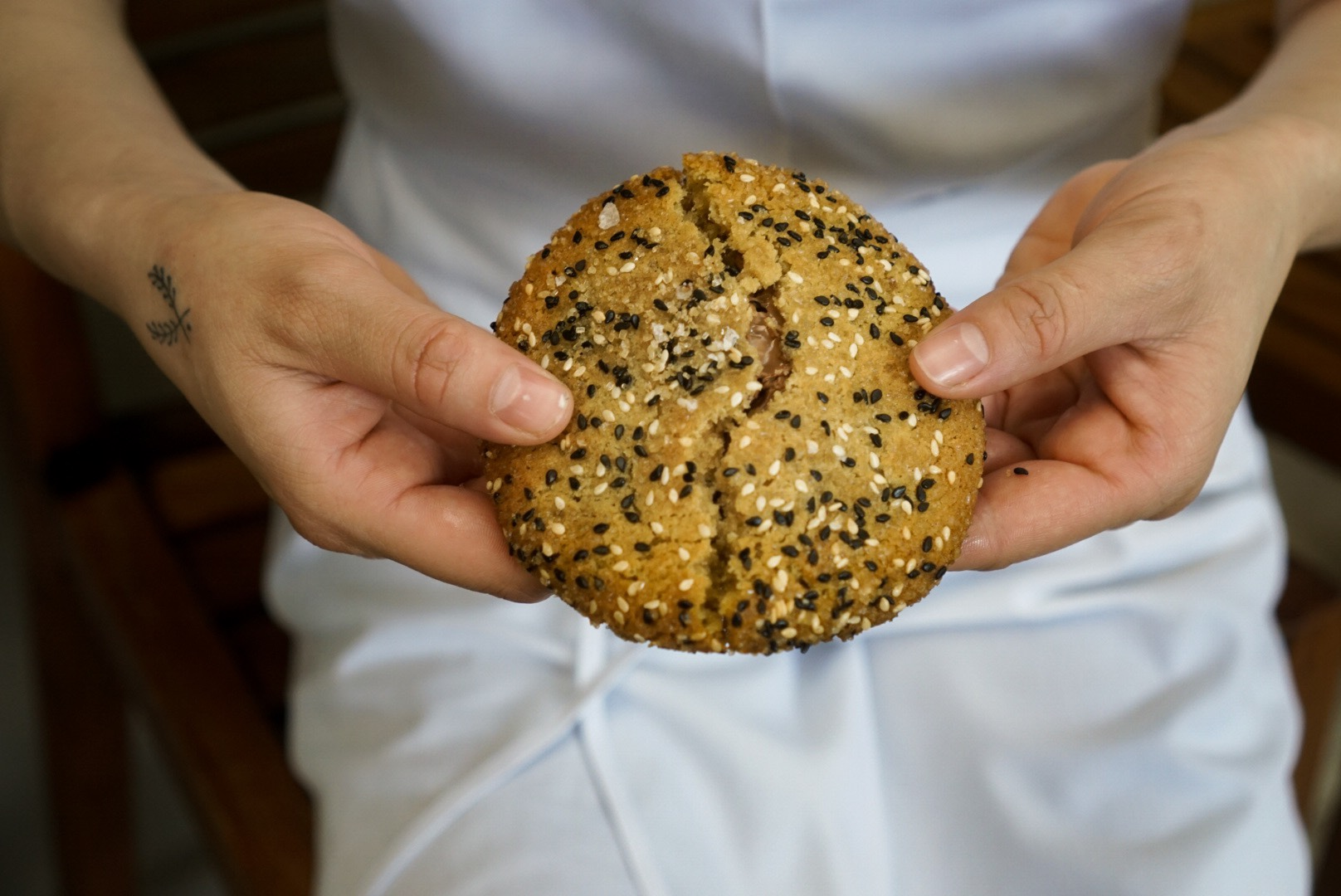 """The result of lots and lots of testing, this cookie is incredibly delicious. (Can you imagine the lucky folks who get to eat the """"mistakes""""?) This final version is a Tahini Shortbread rolled in Sesame Seeds filled with Valrhona Caramelia"""