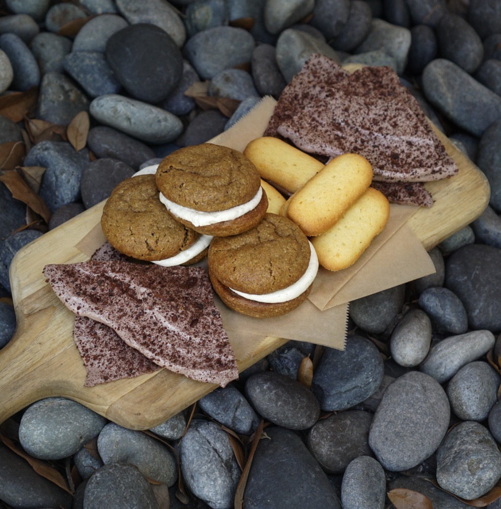 Some of Devin's creations currently at Ariete include And on the board are: Cacao Nib Meringues, Steel Cut Oatmeal Cream Pies and Orange Milanos with Chocolate Hazelnut Ganache.