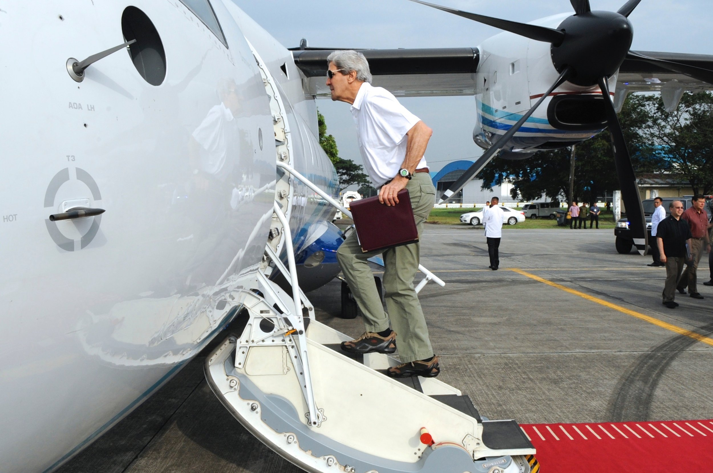 Secretary Kerry boarding a propeller plane for our first trip to the Mekong River.