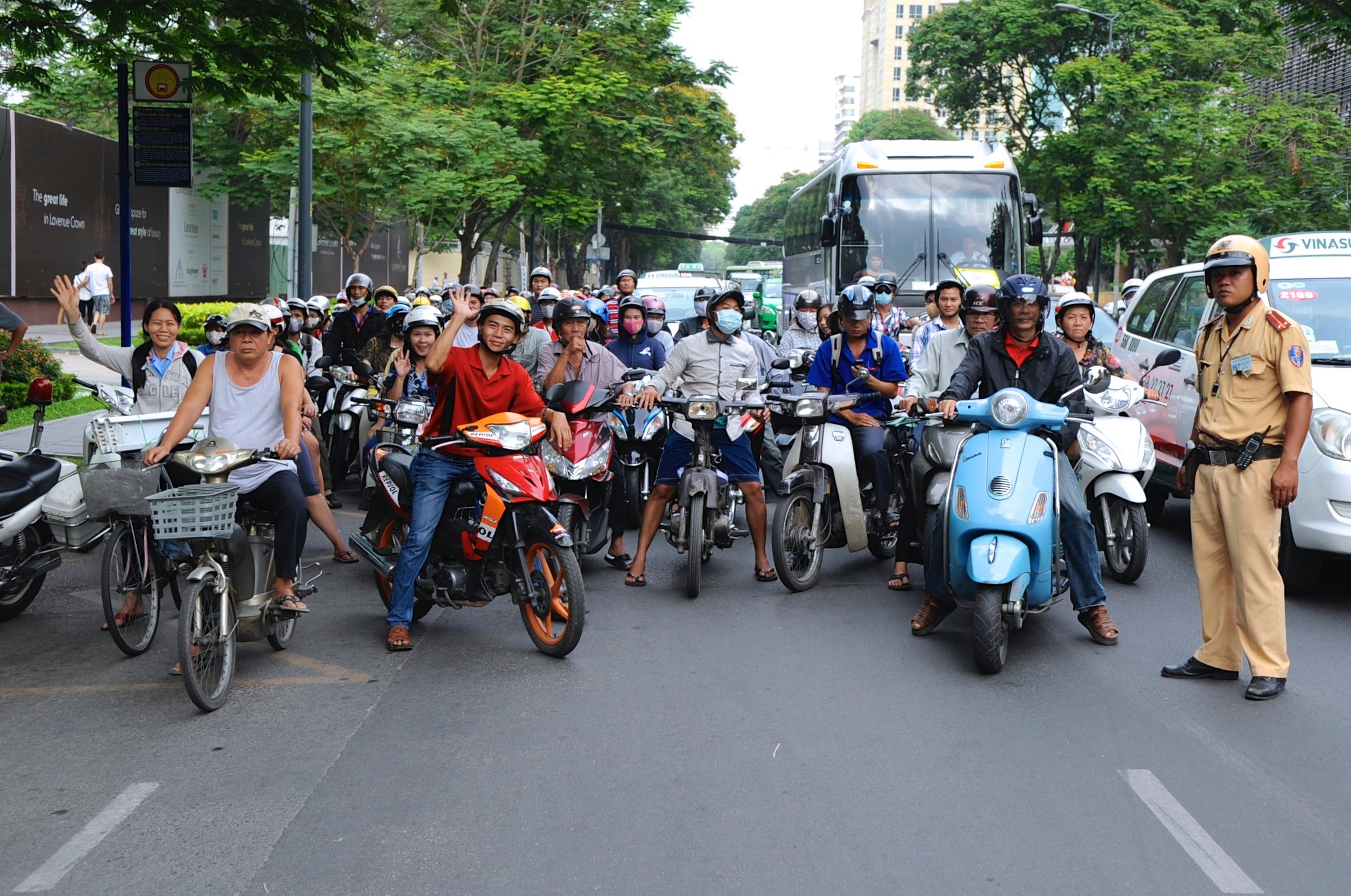Bike riders waiting at the instruction of a police officer for our party to cross the street.