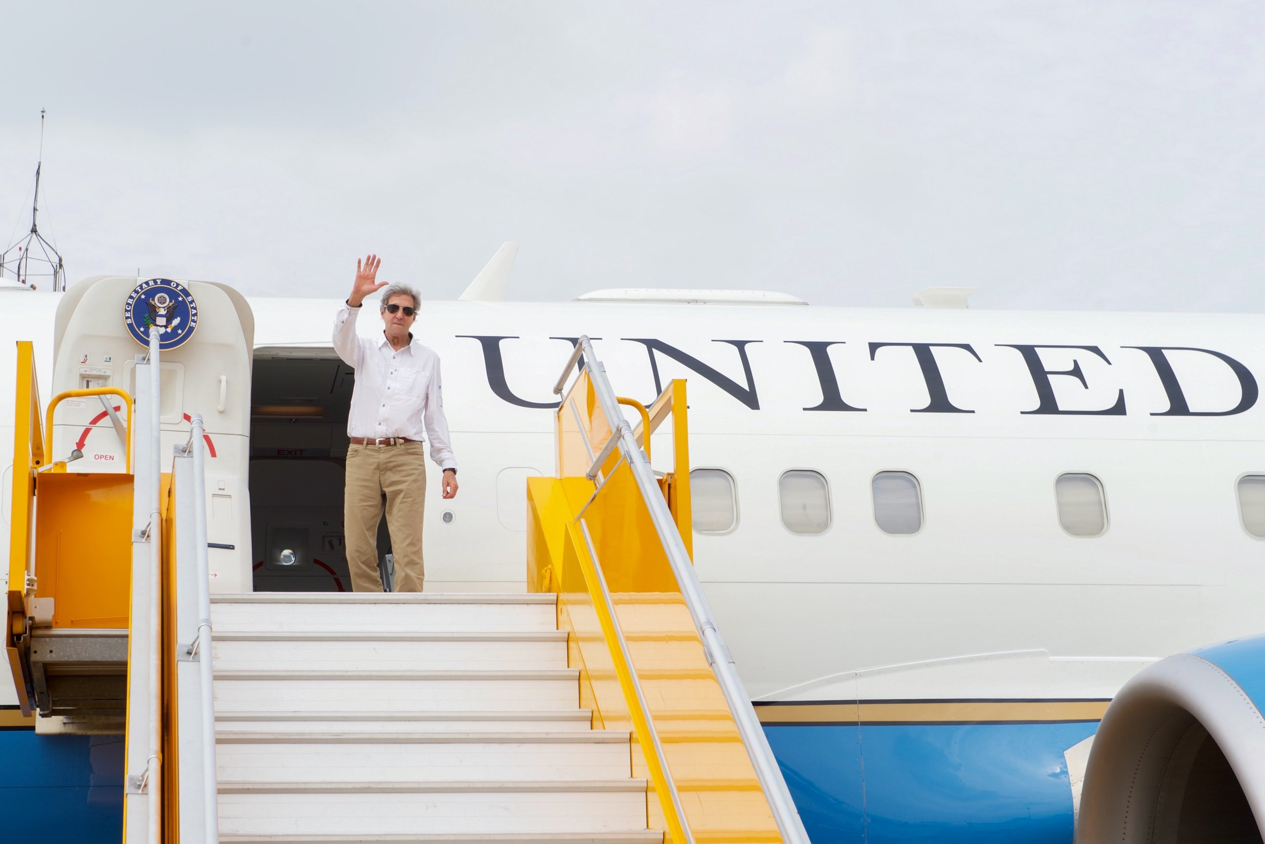John Kerry waves goodbye after his fourth and final trip to Vietnam as Secretary of State.