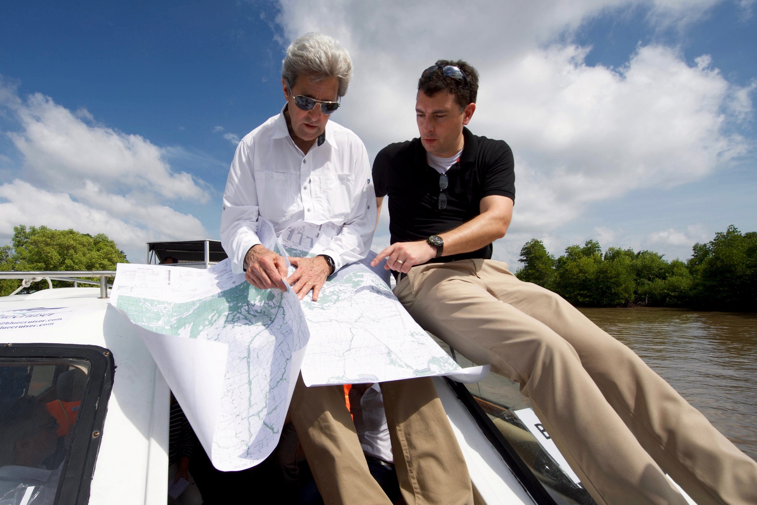 Secretary Kerry looks at vintage maps of South Vietnam brought in by Dartmouth Professor Ed Miller.