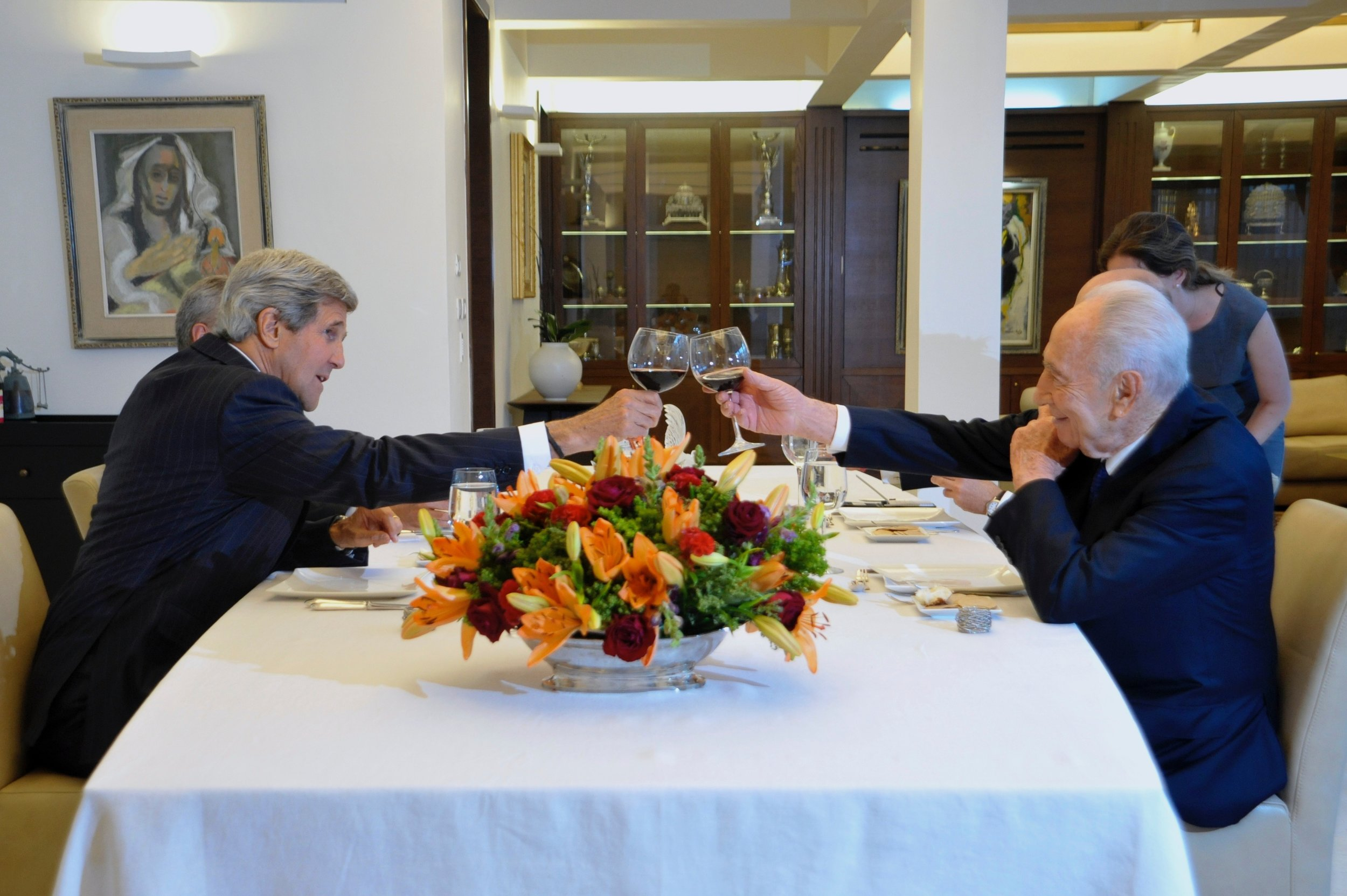 Secretary Kerry shares a Shabbath toast with Israeli President Shimon Peres at his official residence.