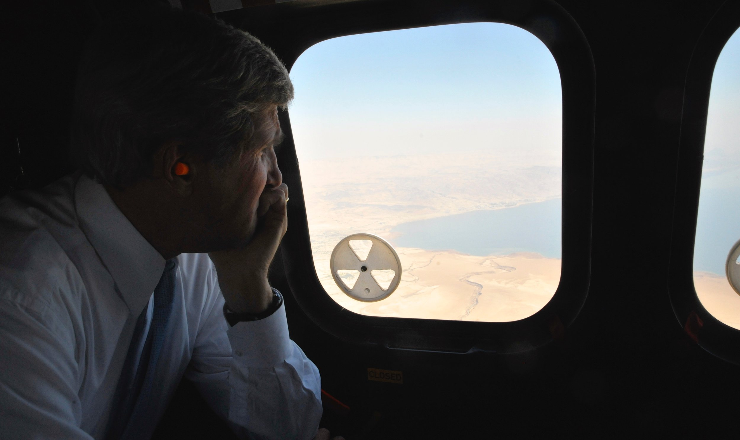 Secretary Kerry looking out at the Dead Sea during one flight between Jordan and Israel.