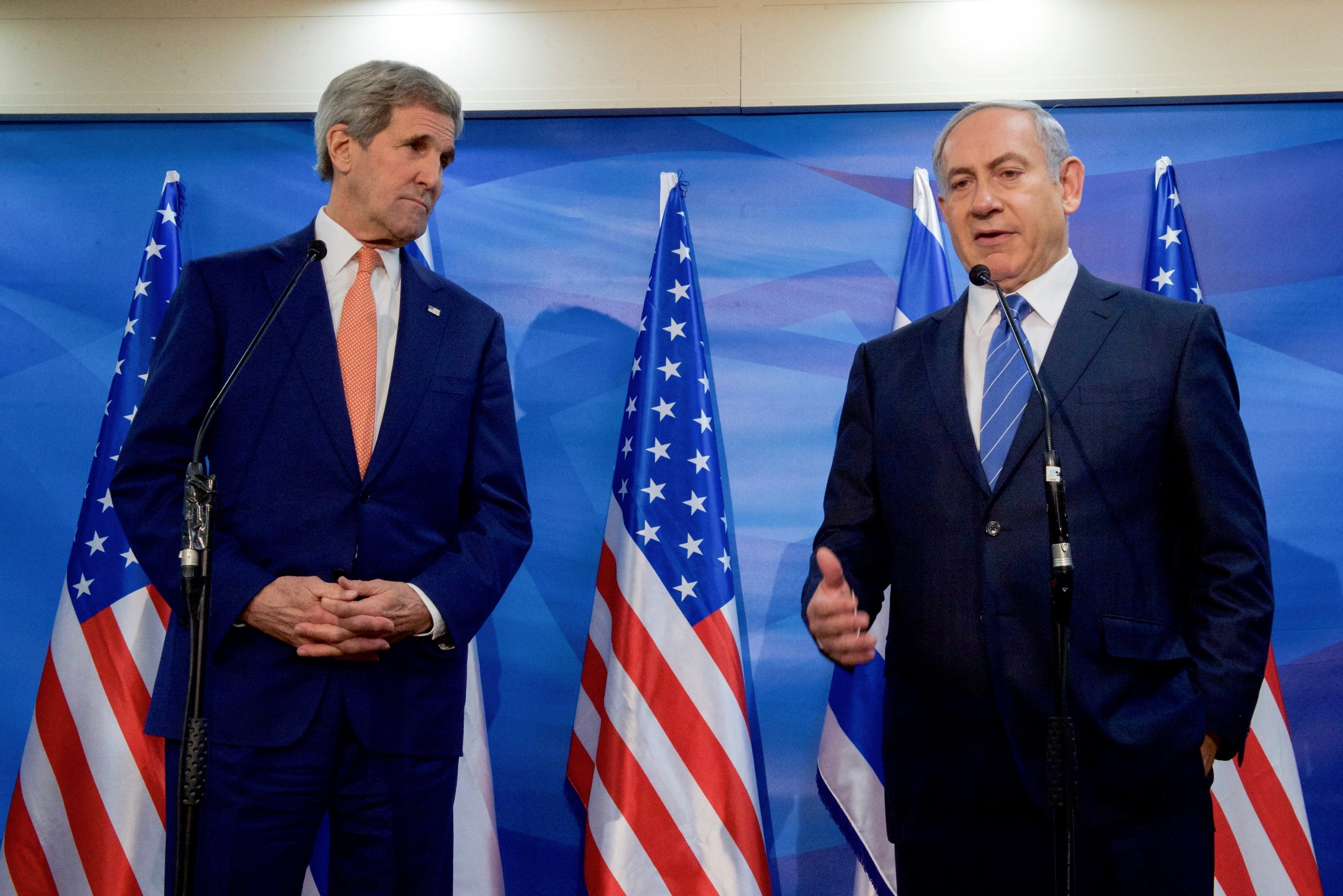 Secretary Kerry listening as Prime Minister Netanyahu addresses reporters outside his office in Jerusalem.