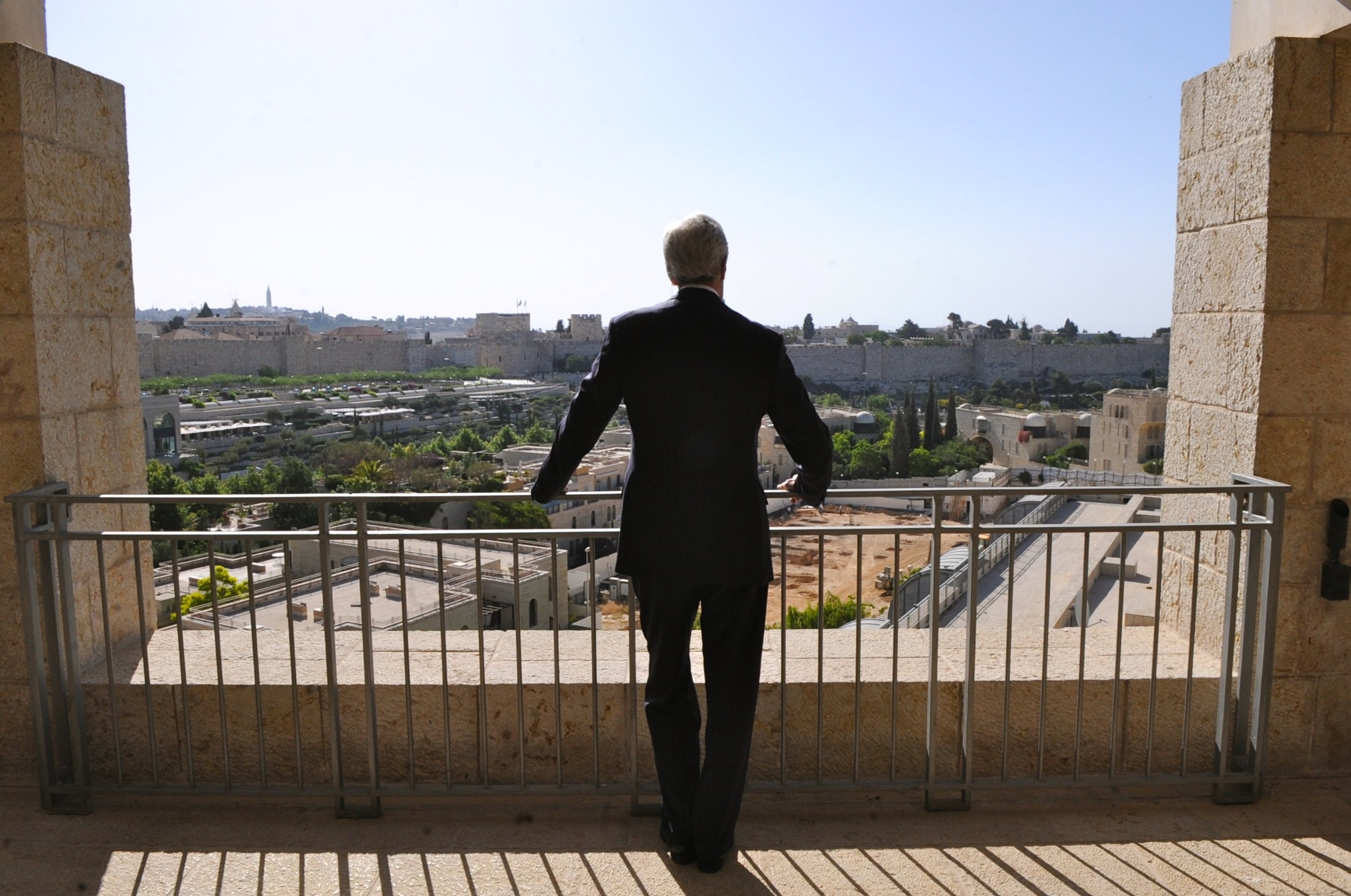 Secretary Kerry looks out at the Old City of Jerusalem from the balcony of the Rabin Suite at the David Citadel Hotel.