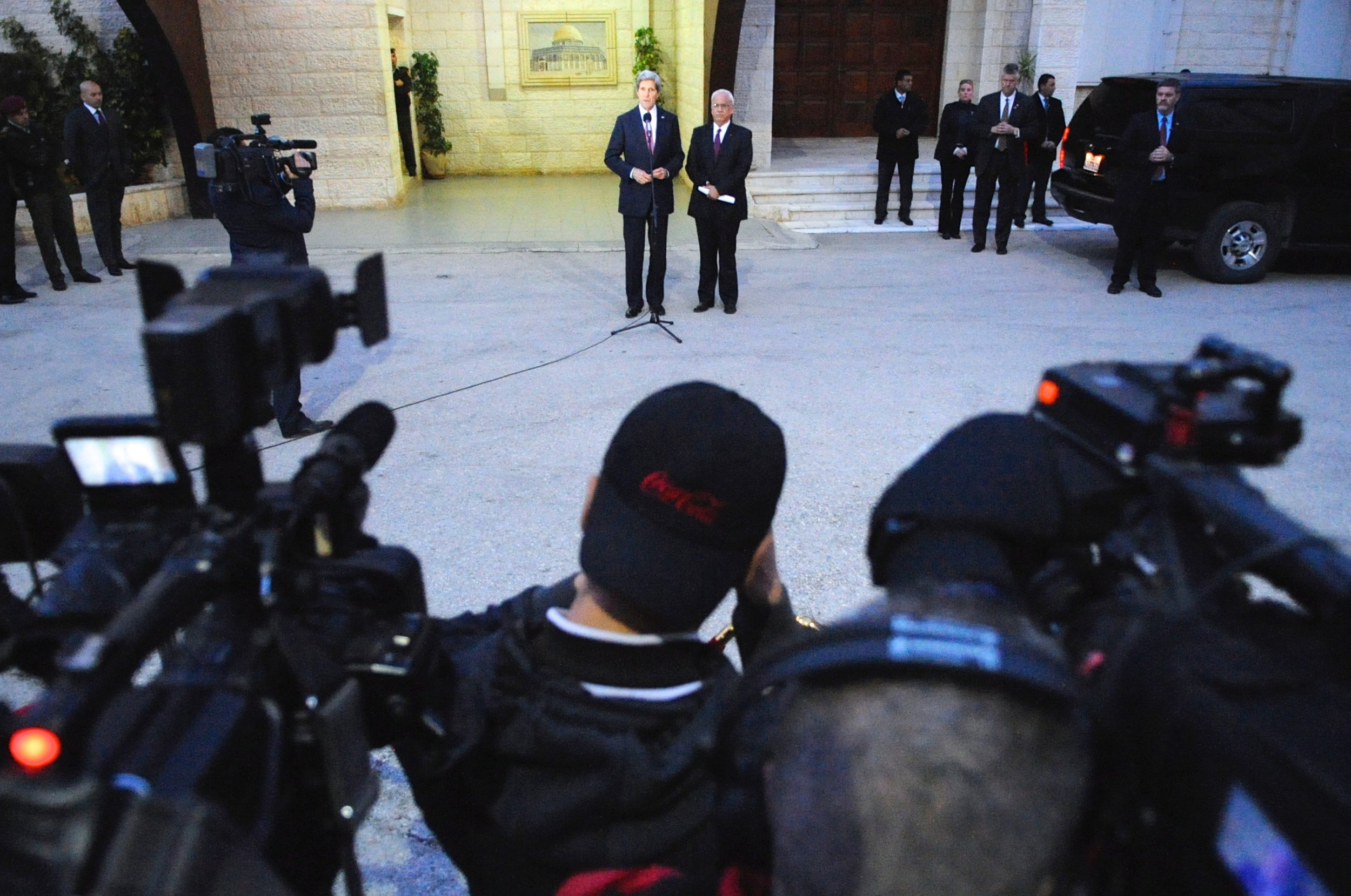 Secretary Kerry and Saeb Arakat address reporters outside the Palestinian Authority Headquarters in Ramallah, West Bank.