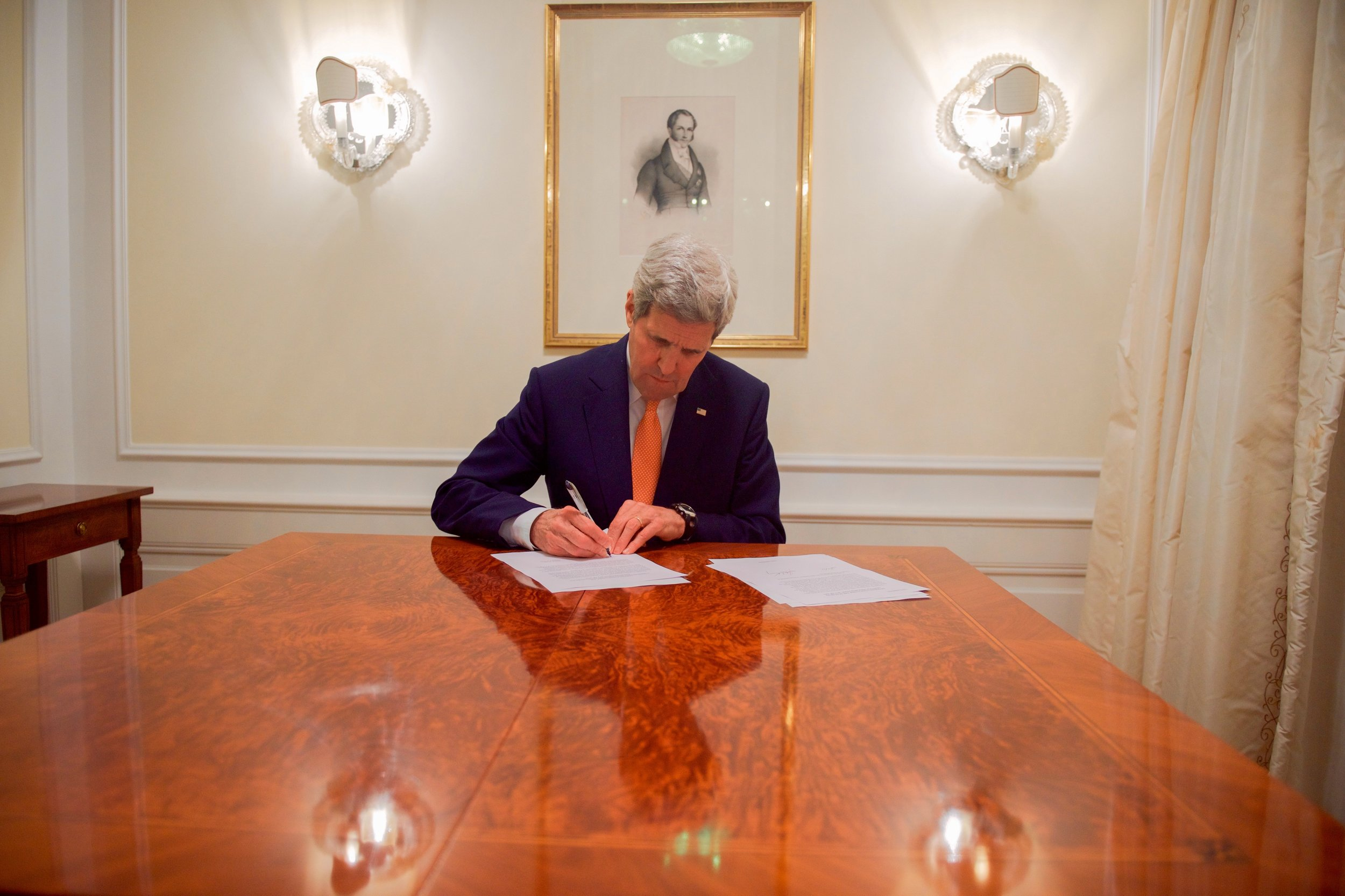 Secretary Kerry signing sanctions relief for Iran after it agreed to the final terms of the nuclear deal.