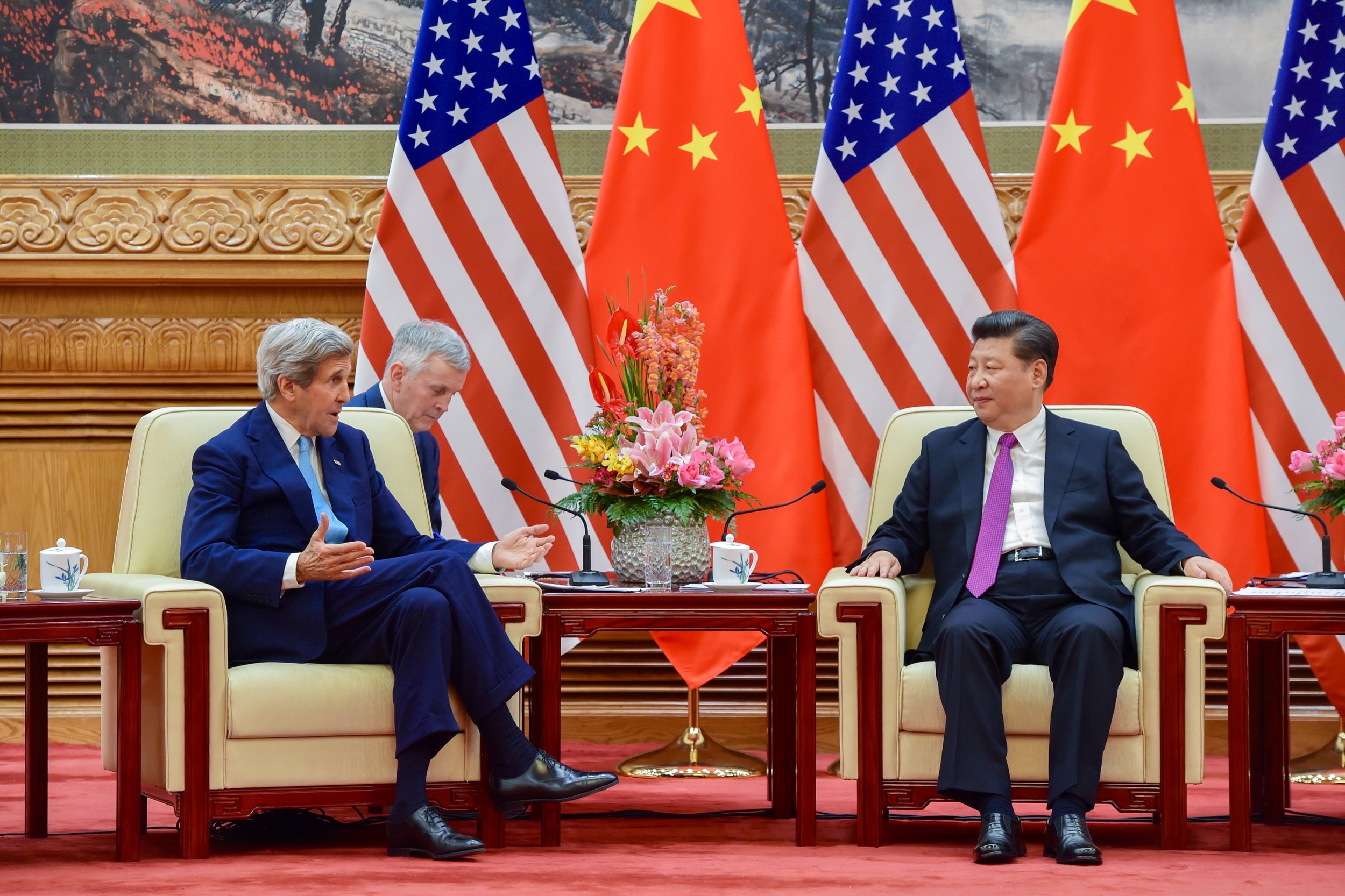 Secretary Kerry speaks with President Xi in a meeting room at the Great Hall of the People.