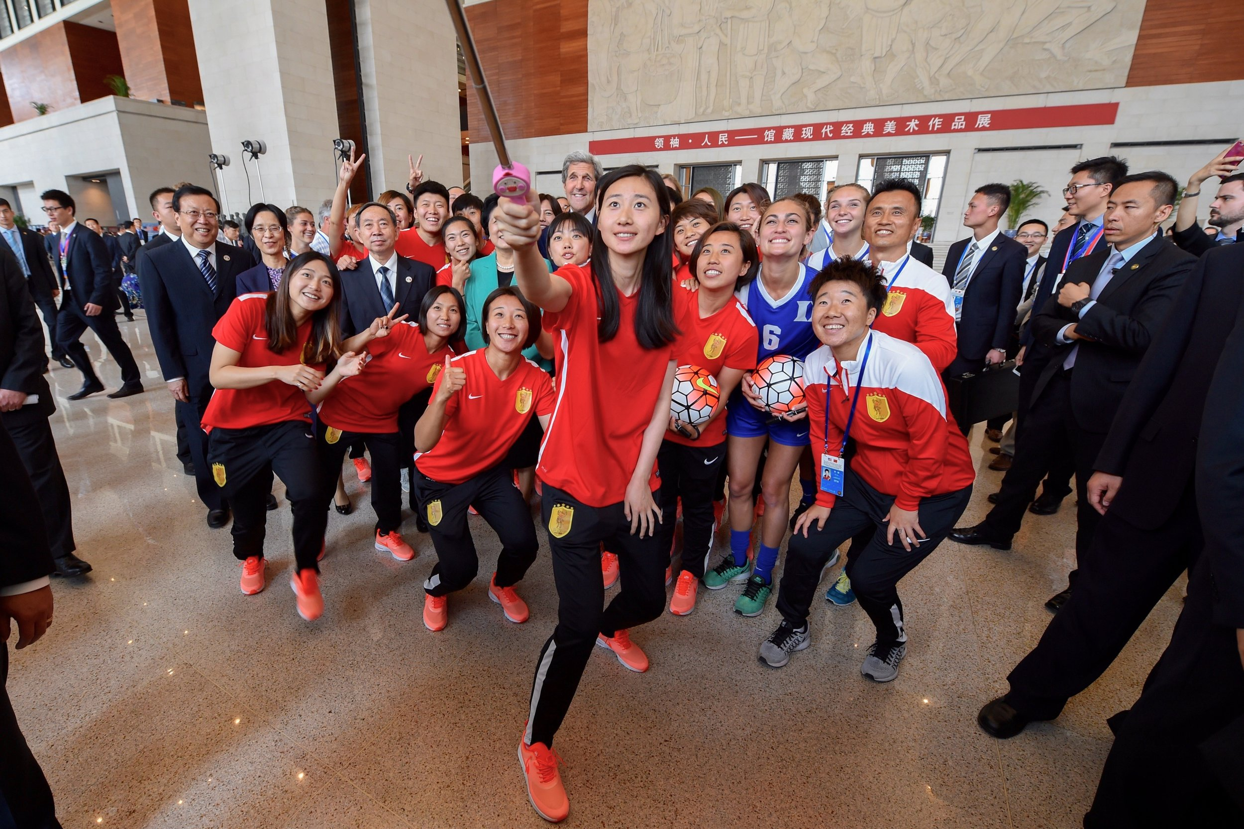 A photo with a Chinese soccer team during a visit to the National Museum on Tiananmen Square.