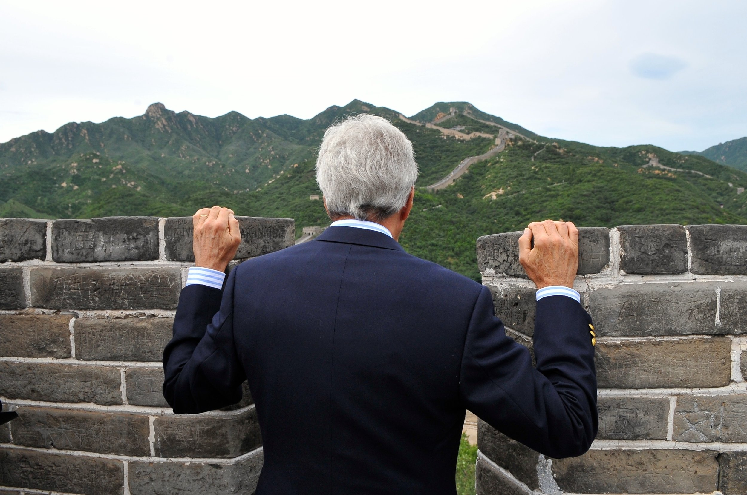 Secretary Kerry peers over a section of the Great Wall at Badalang.