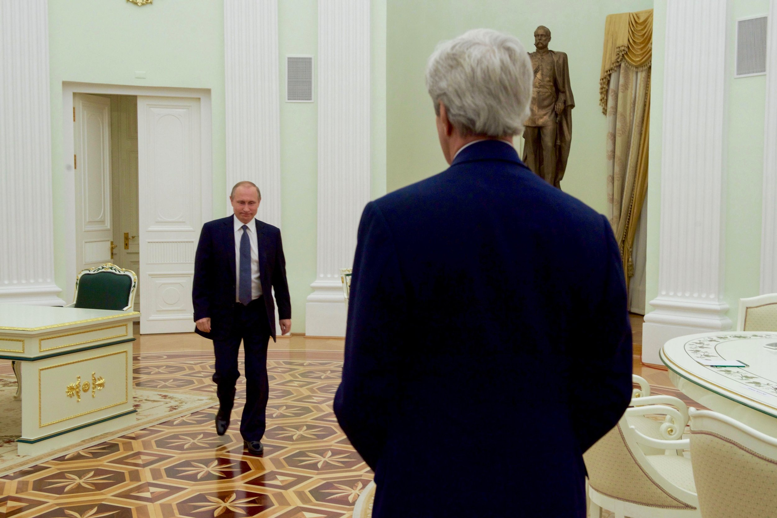 President Putin enters to greet Secretary Kerry - after keeping him waiting for hours.
