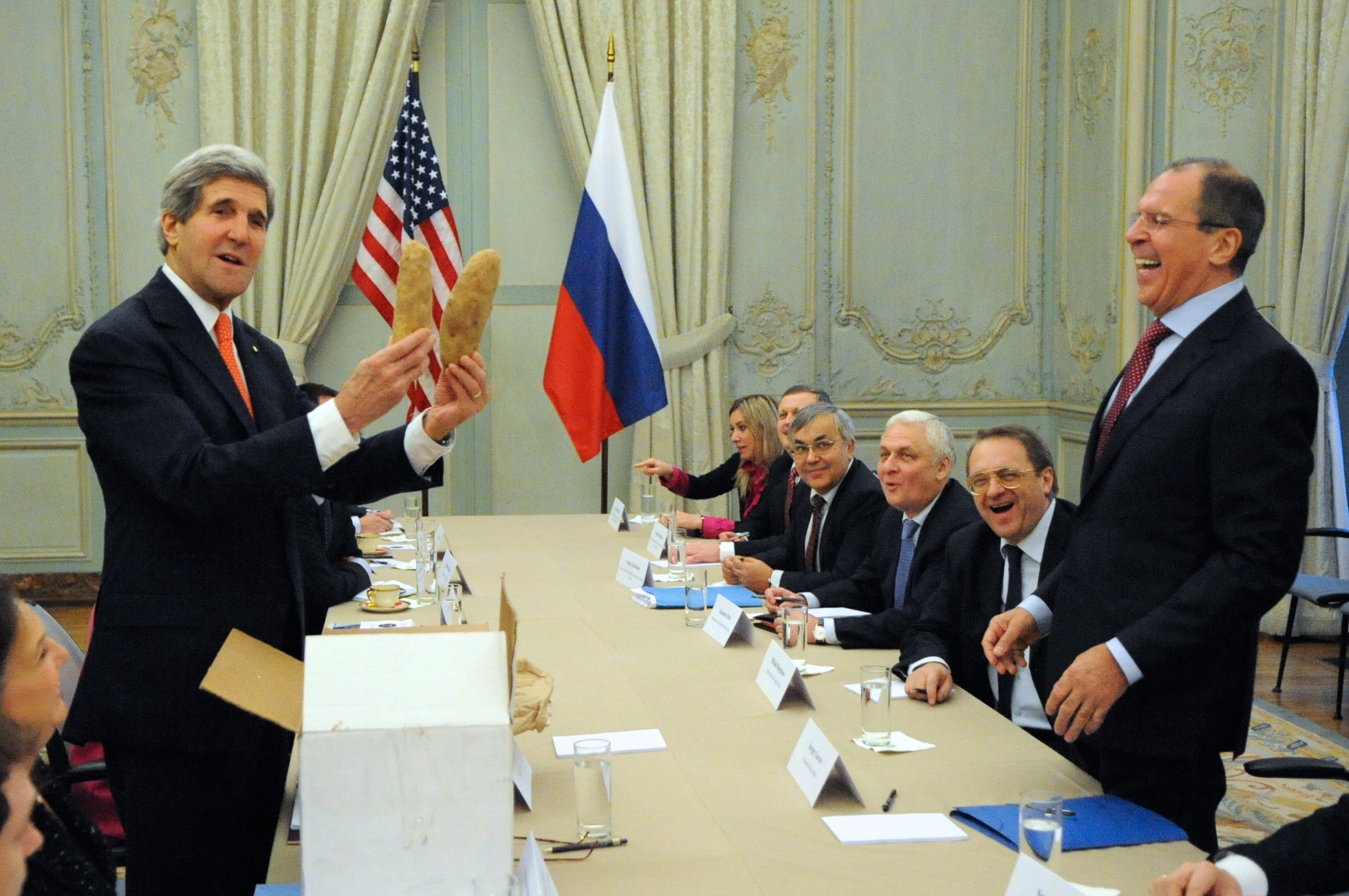 Secretary Kerry engages in potato diplomacy with Russian Foreign Minister Lavrov during a meeting in Paris.