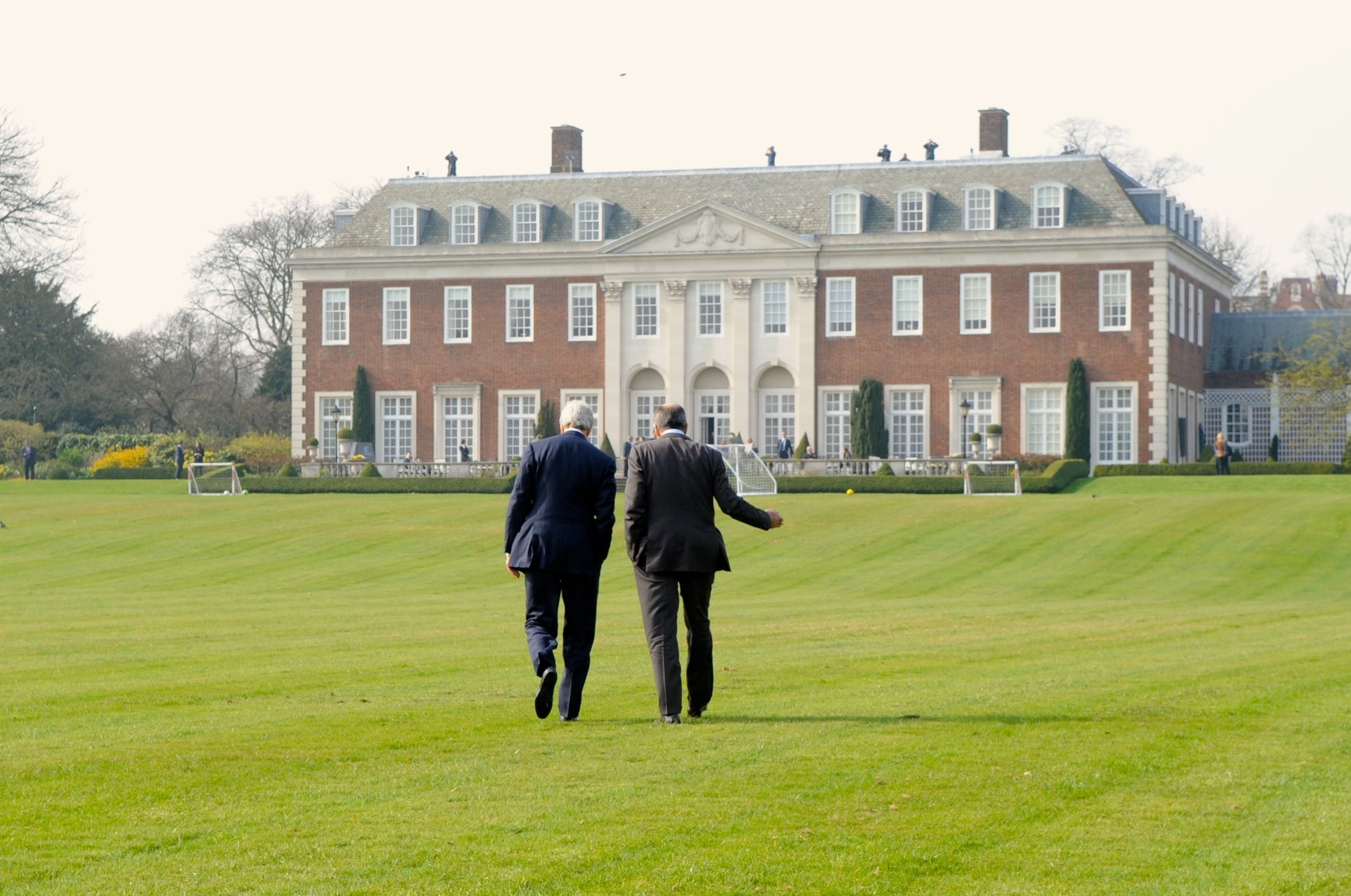 The two diplomats take a walk on the back lawn at Winfield House - the second-largest private yard in London, after the one at Buckingham Palace.