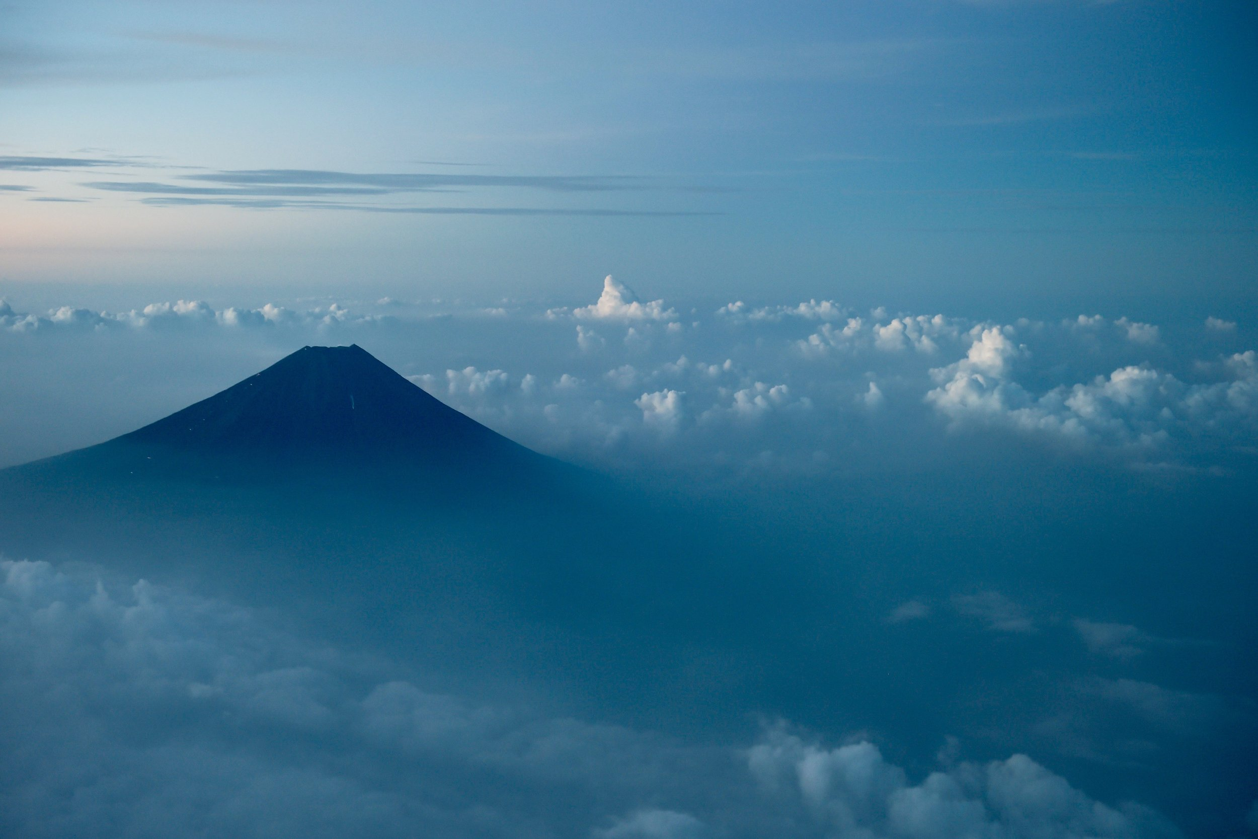 A sunrise view of Mt. Fuji during our arrival in Japan amid one of our 10 around-the-world trips.