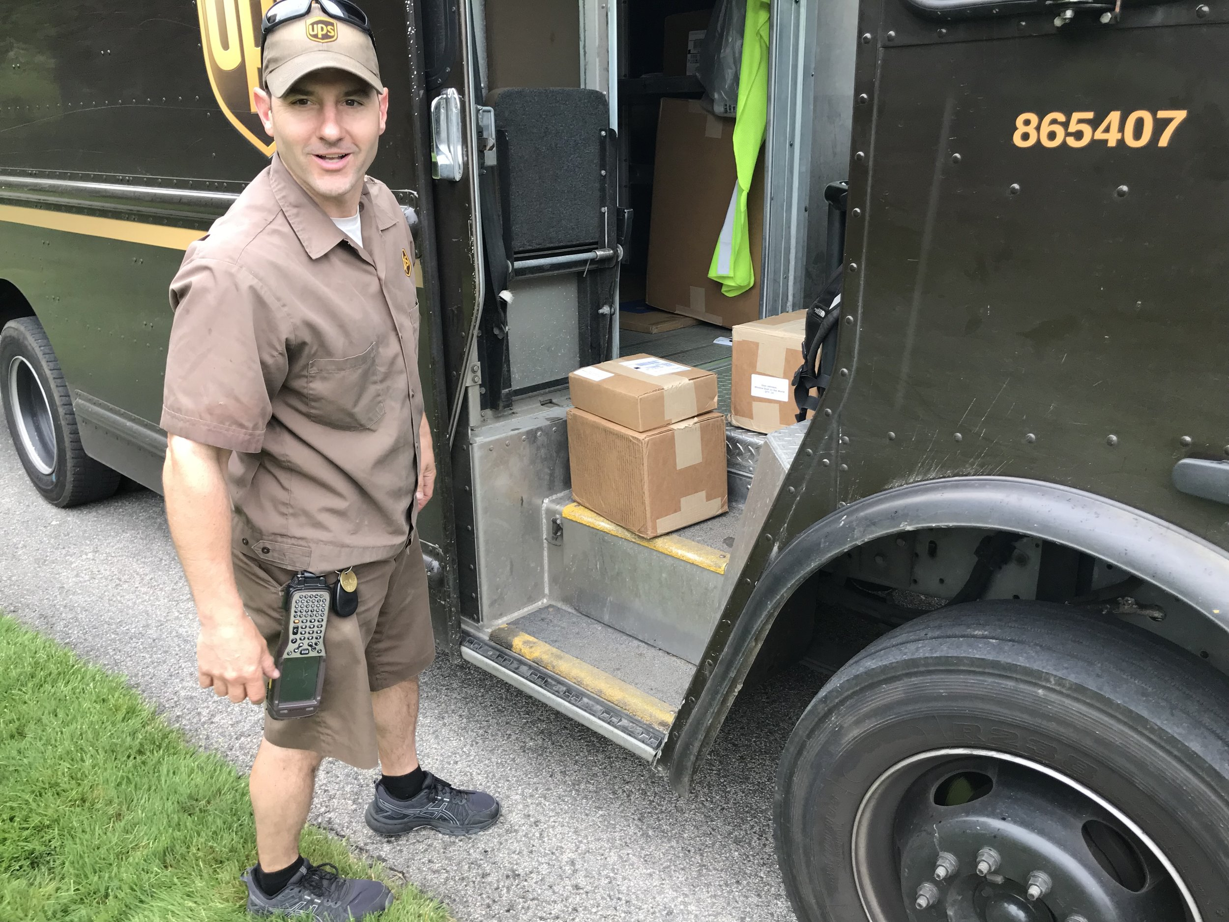 My UPS driver delivering the first batch of completed books. He insisted on carrying them into my house for me.