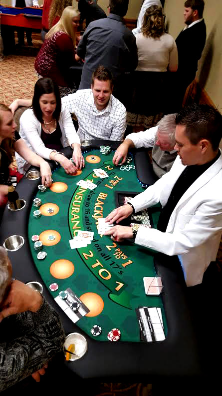 Chad dealing 21 while guests REFERENCE the strategy cards we distribute to make sure they are playing OPTIMAL blackjack
