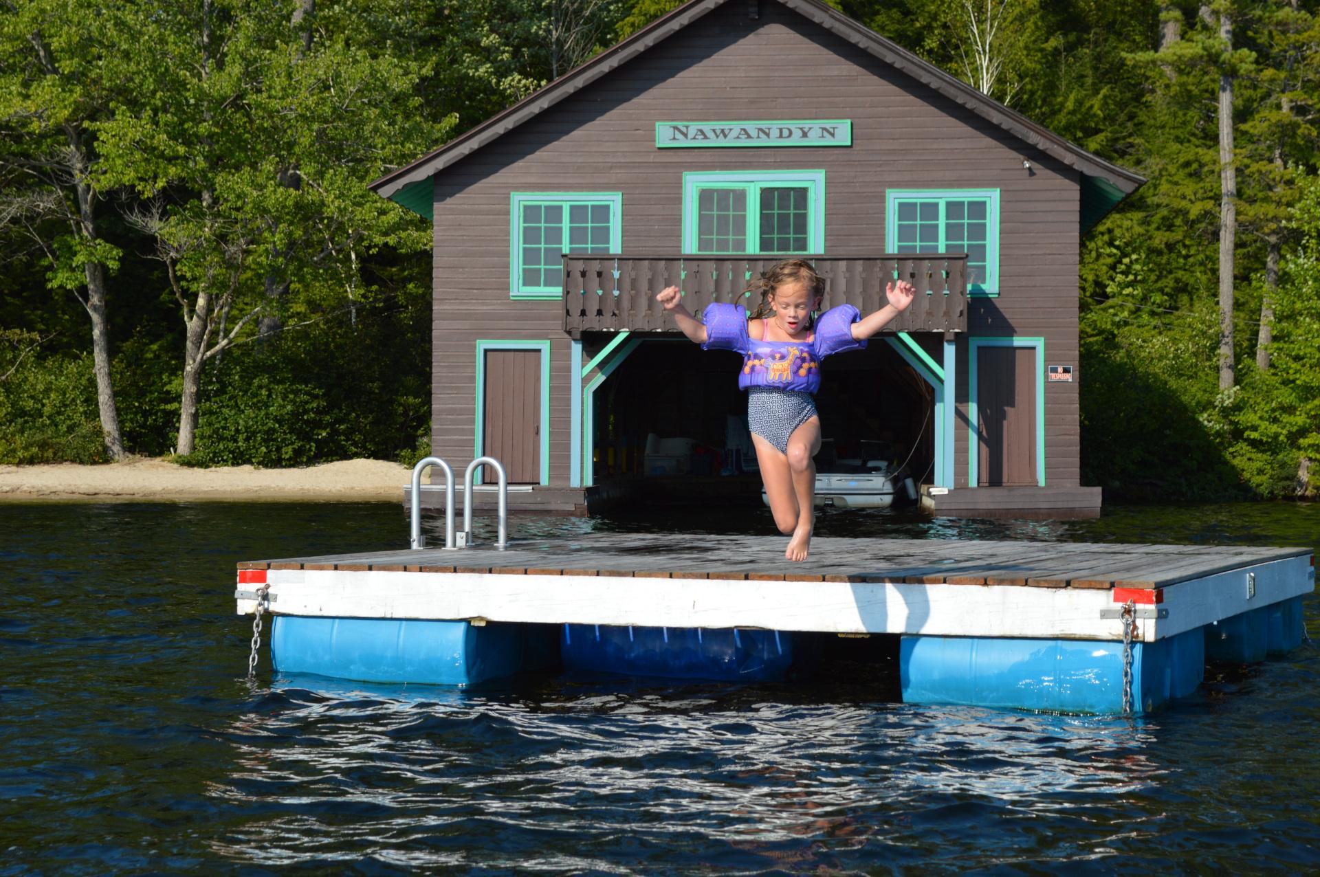 Joy!  Jump from Nawandyn's Swim Raft into Warm, Clear Water