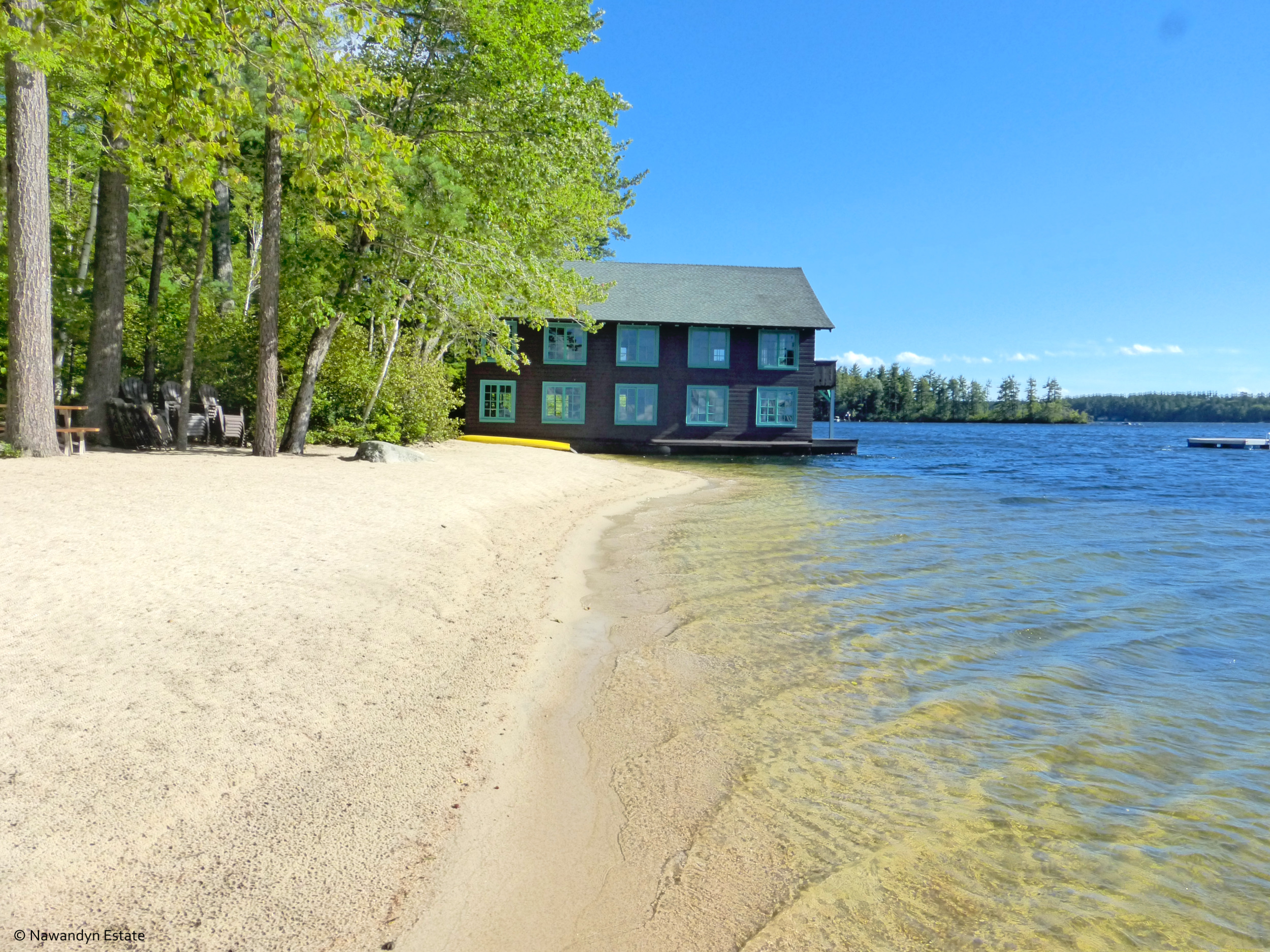 Private long sandy beach abuts Nawandyn Estate's boathouse