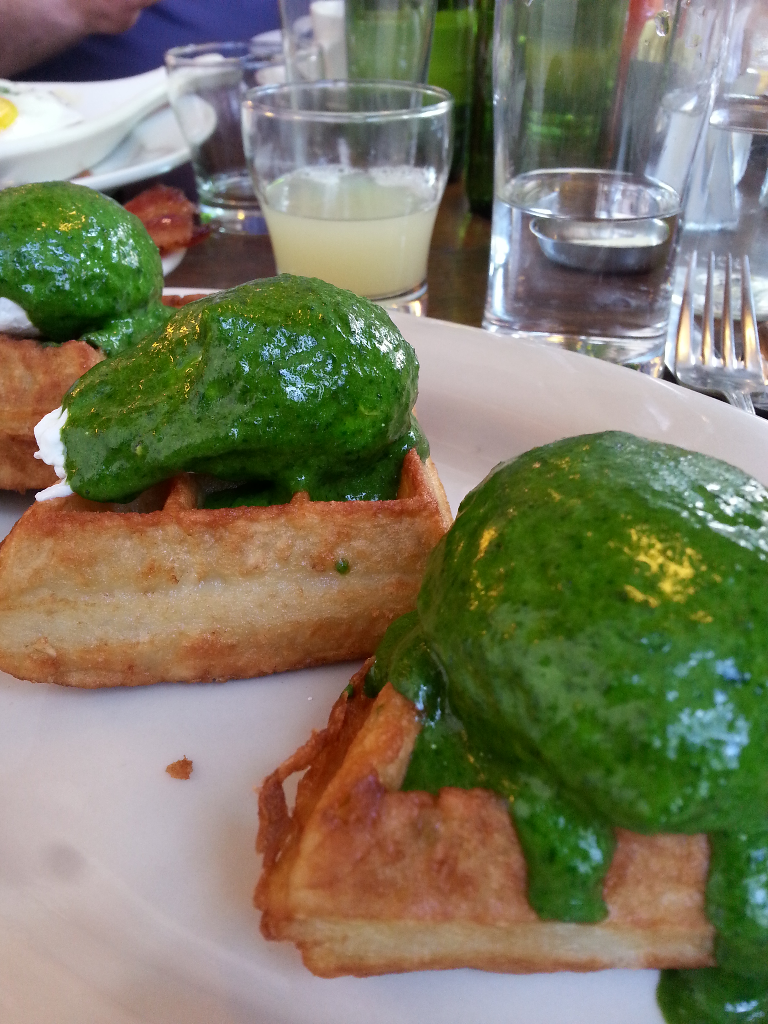 Potato waffle with creamed spinach and poached eggs