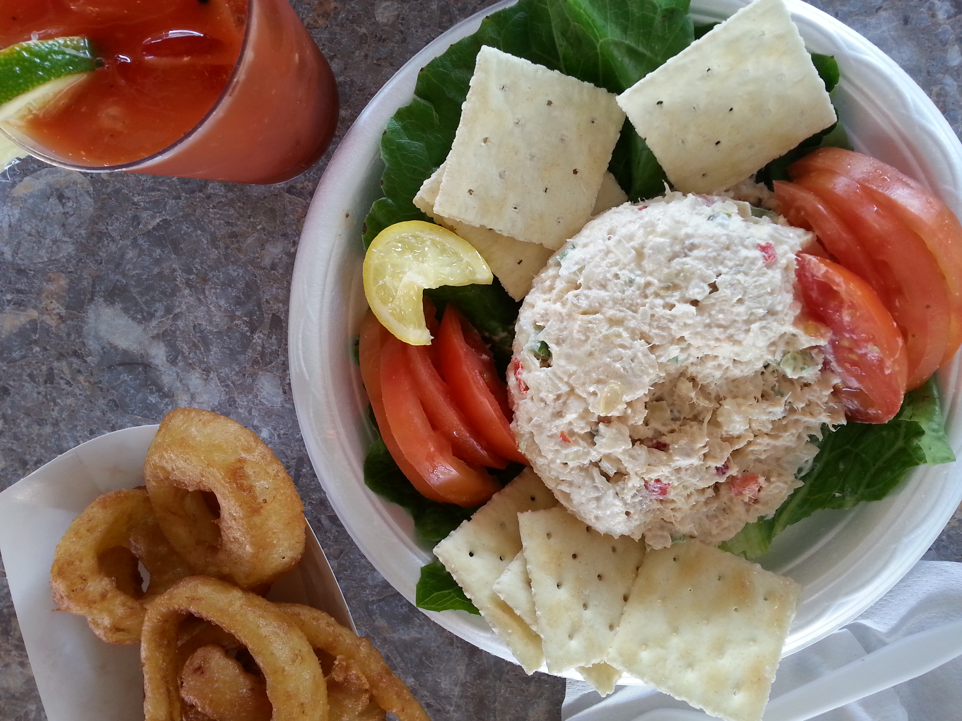 Grouper salad with onion rings and a Bloody Mary