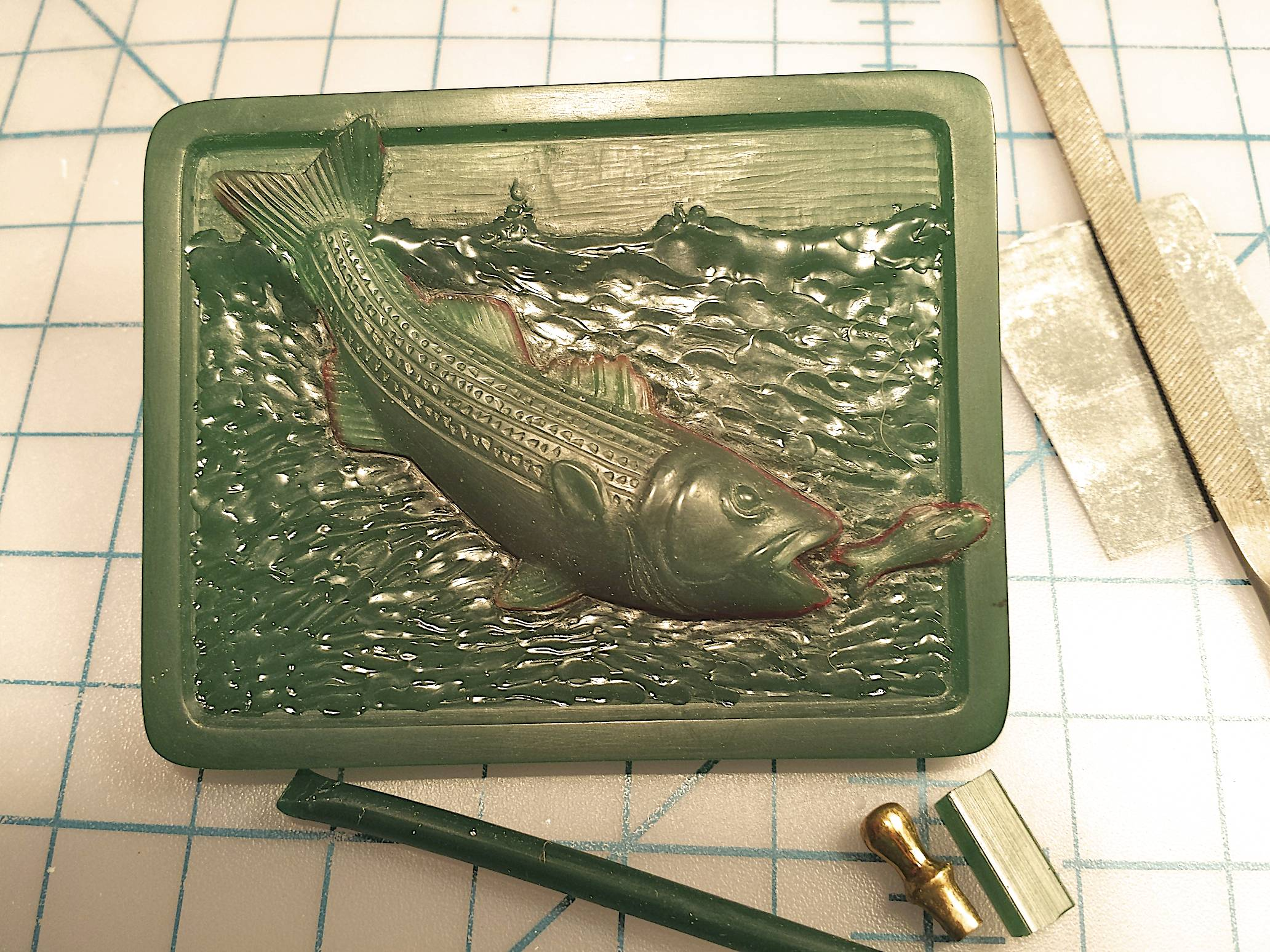 Adding the water,tops of the waves and the bait fish.