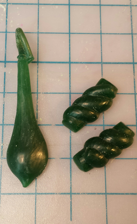 Wax models of the Wisteria Seedpod and Cufflinks