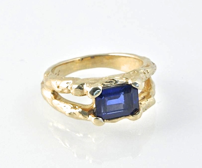 14K Yellow Gold, Twig and Sapphire Engagement Ring. The custom engagement ring washand carved and cast with the 1 carat sapphire.