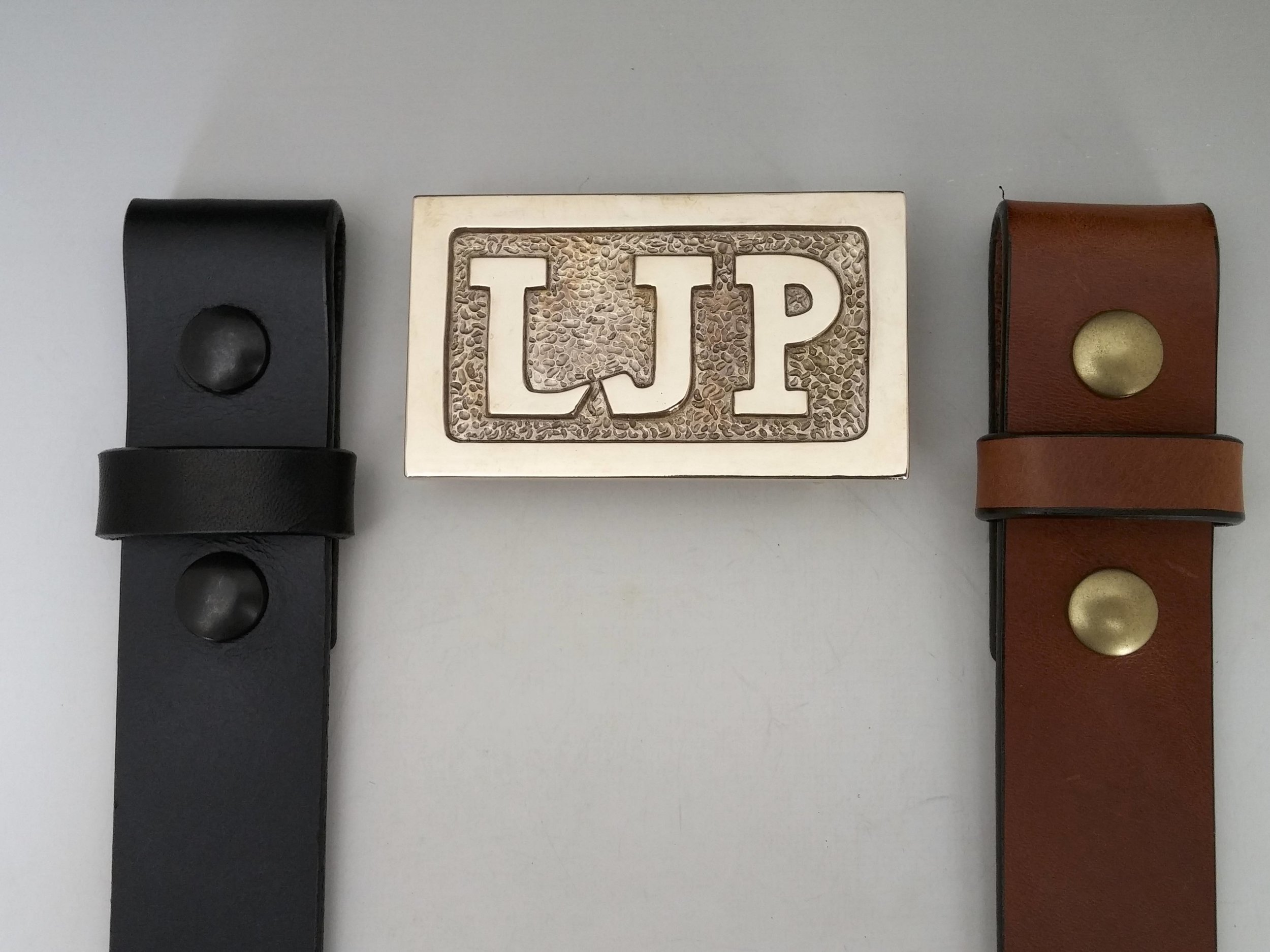 Coming soon with either a handmade black or chestnut belt.     Ask for your custom, personalized initials belt.